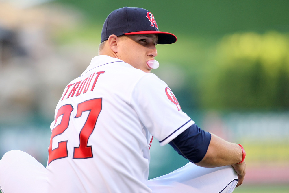 A half-hour before his 2011 major league debut, Mike Trout stretches on the field and blows a bubble.