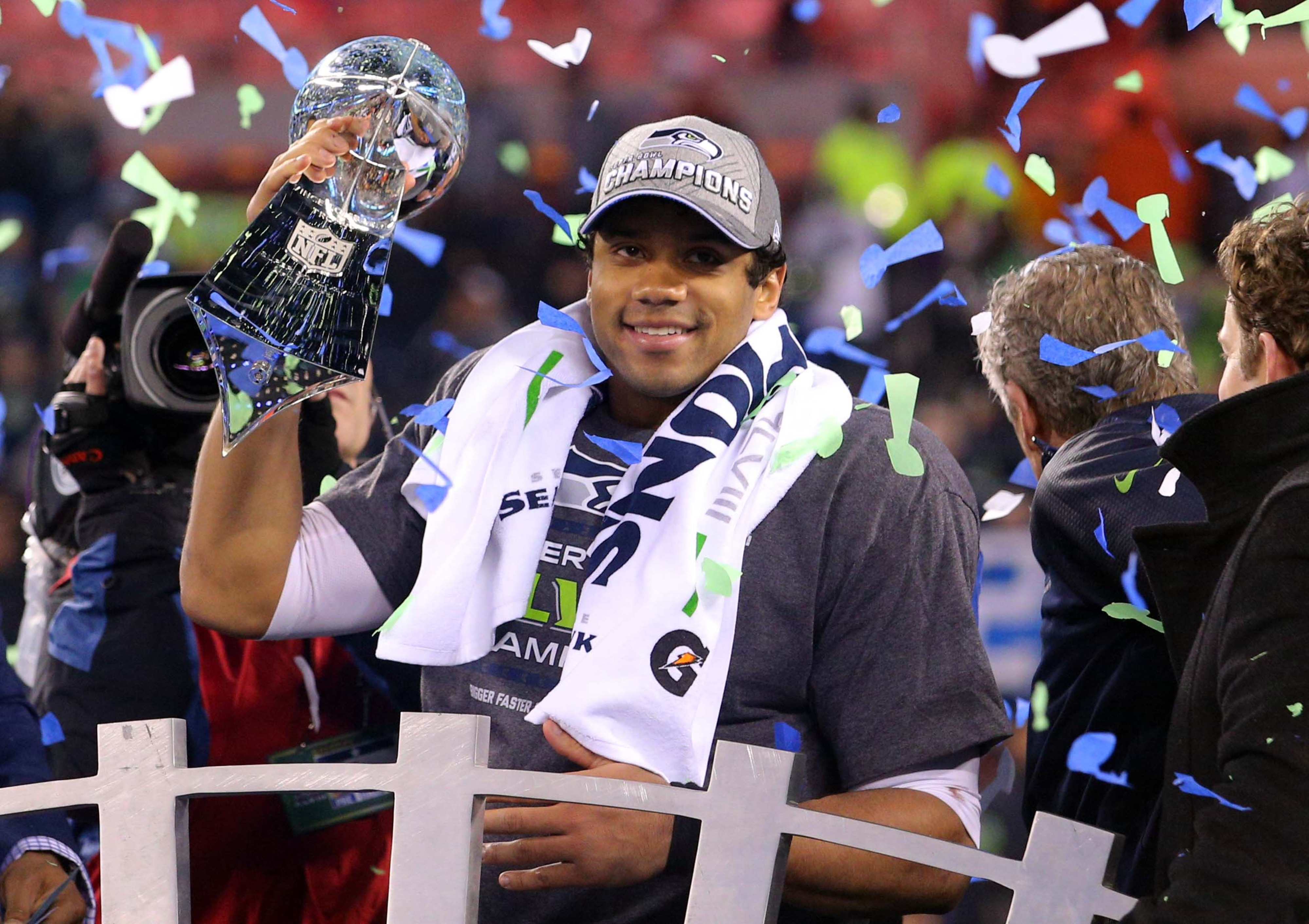Super Bowl champion Russell Wilson will still be at Rangers spring training