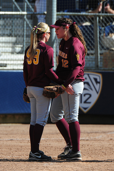 Pitchers Dallas Escobedo and Mackenzie Popescue are big fans of their new coach.