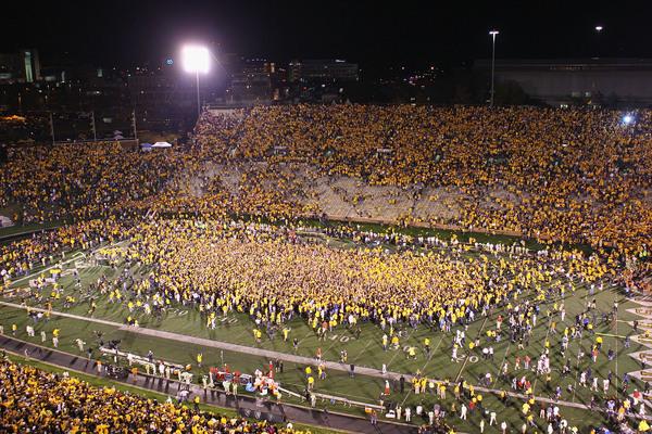Missouri initiates gather after sacrificing No. 1 Oklahoma.