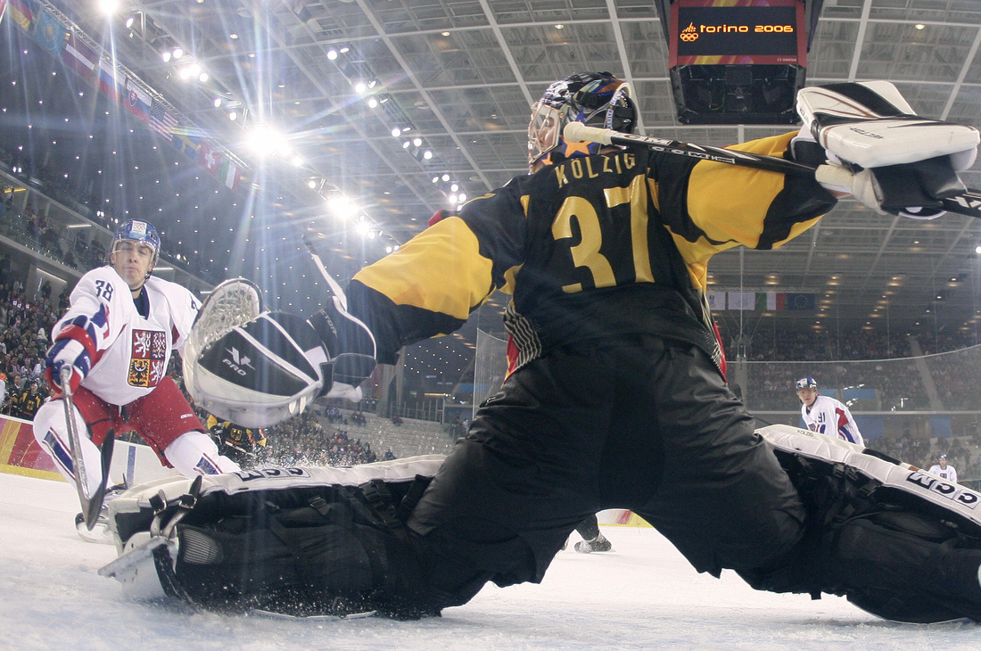 Olie Kolzig makes a save on Jan Bulis in the 2006 Olympics in Torino