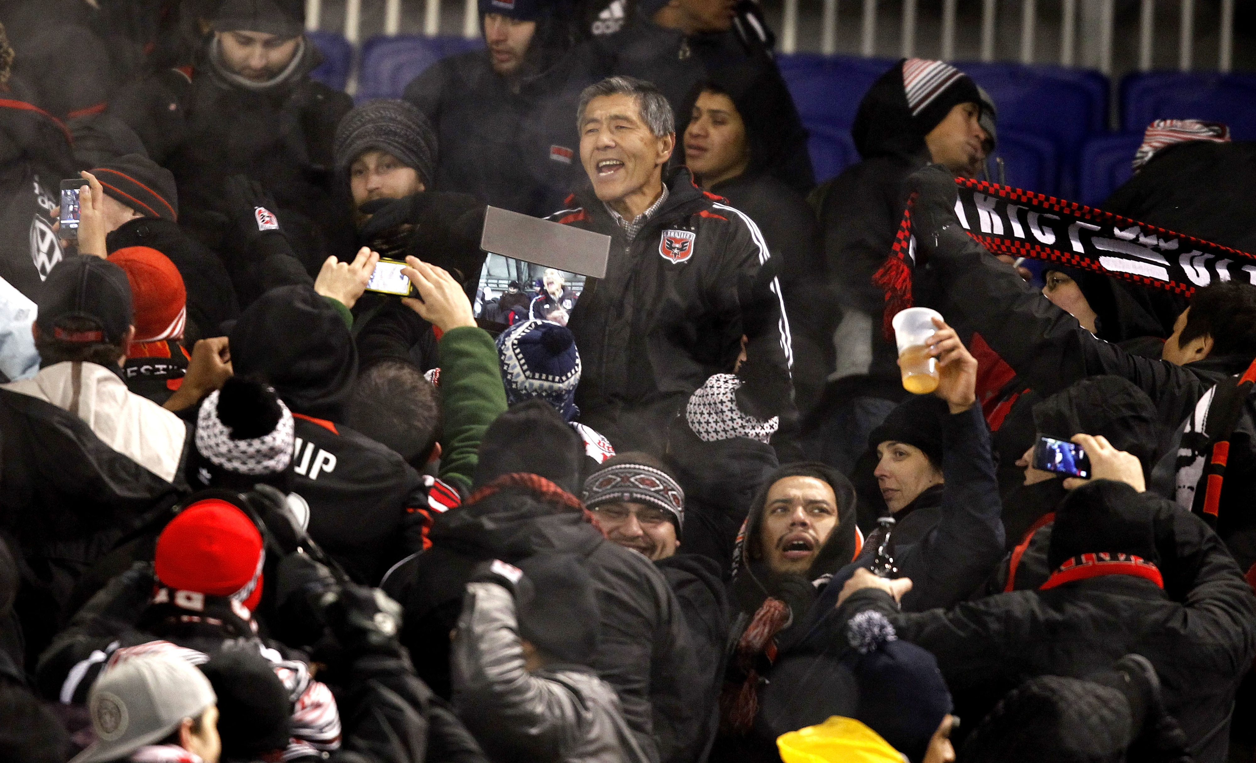 D.C. United owner Will Chang greets fans after the postponement was announced Wednesday night.