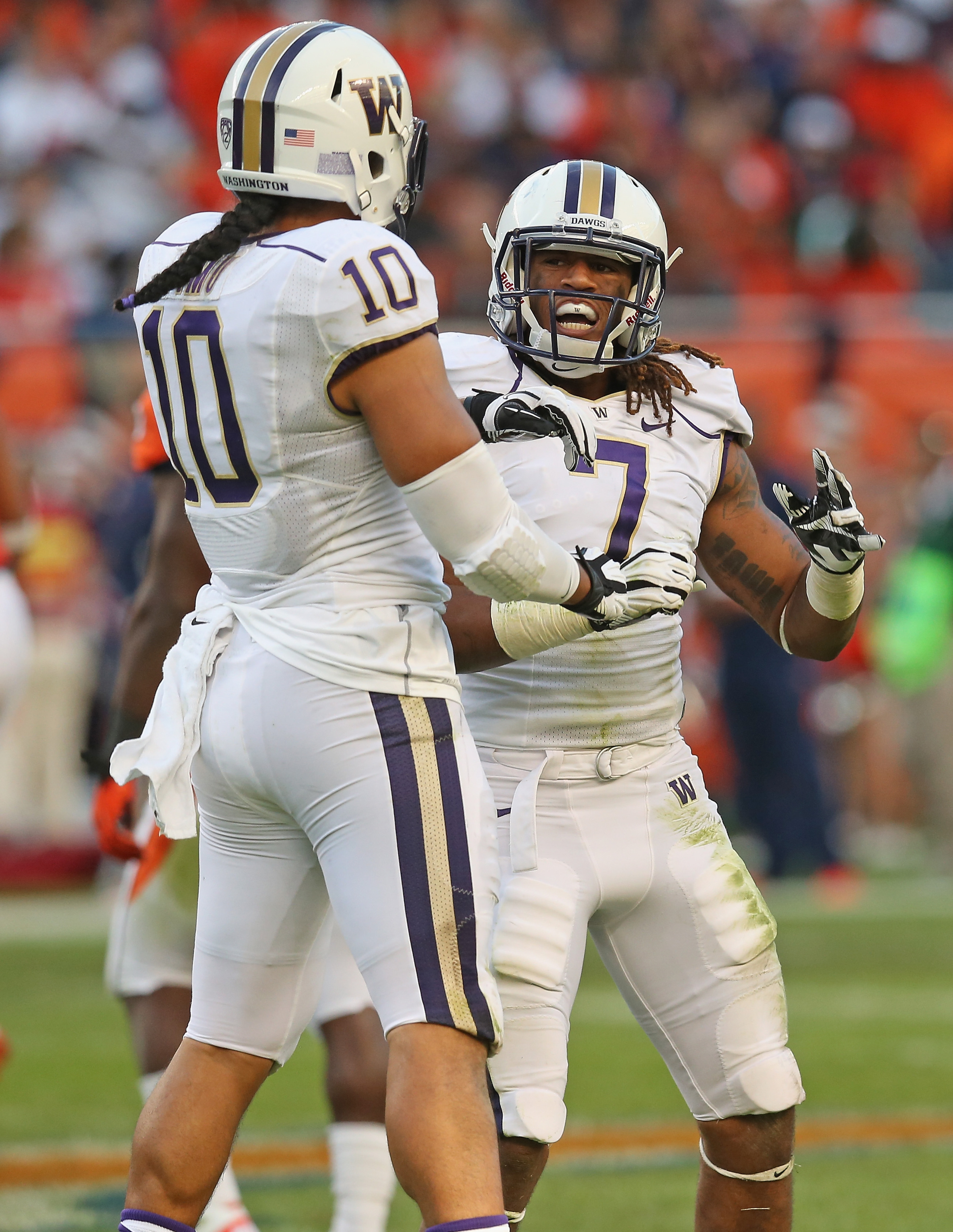 John Timu and Shaq Thompson will again anchor your Husky linebacking corps in 2014.
