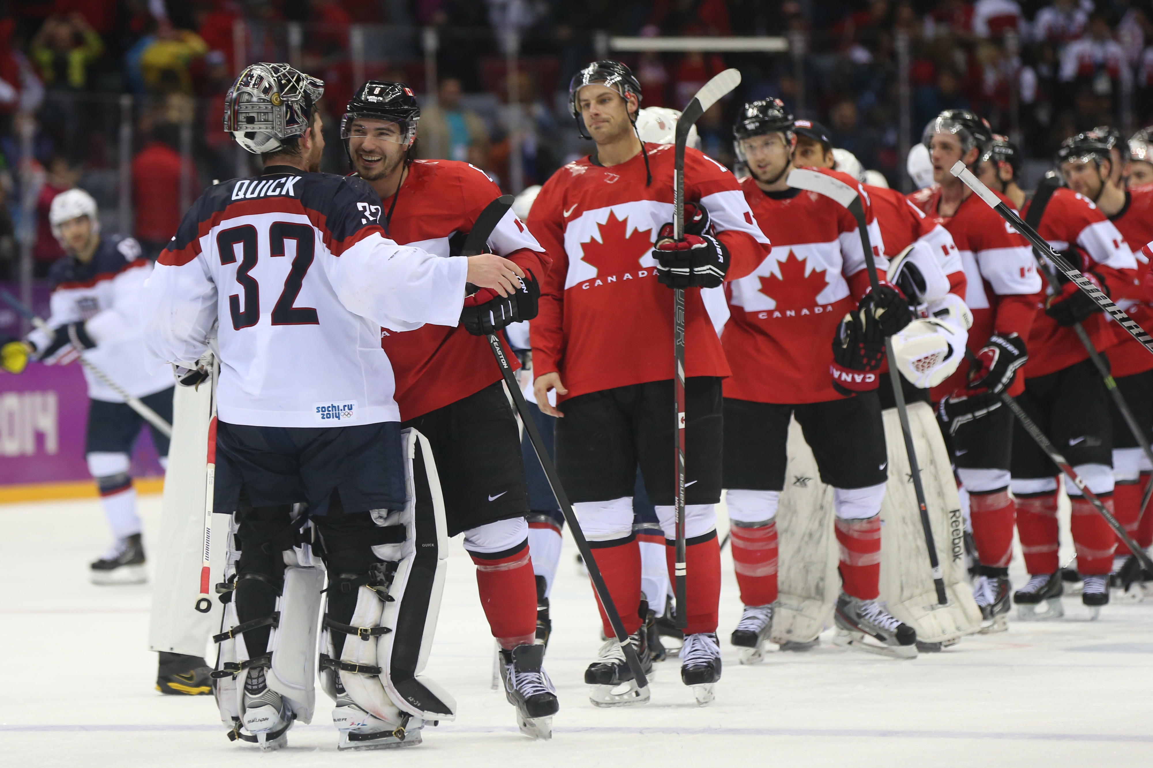 Even after the game, Quick had to weather a bunch of Canadians coming right at him.