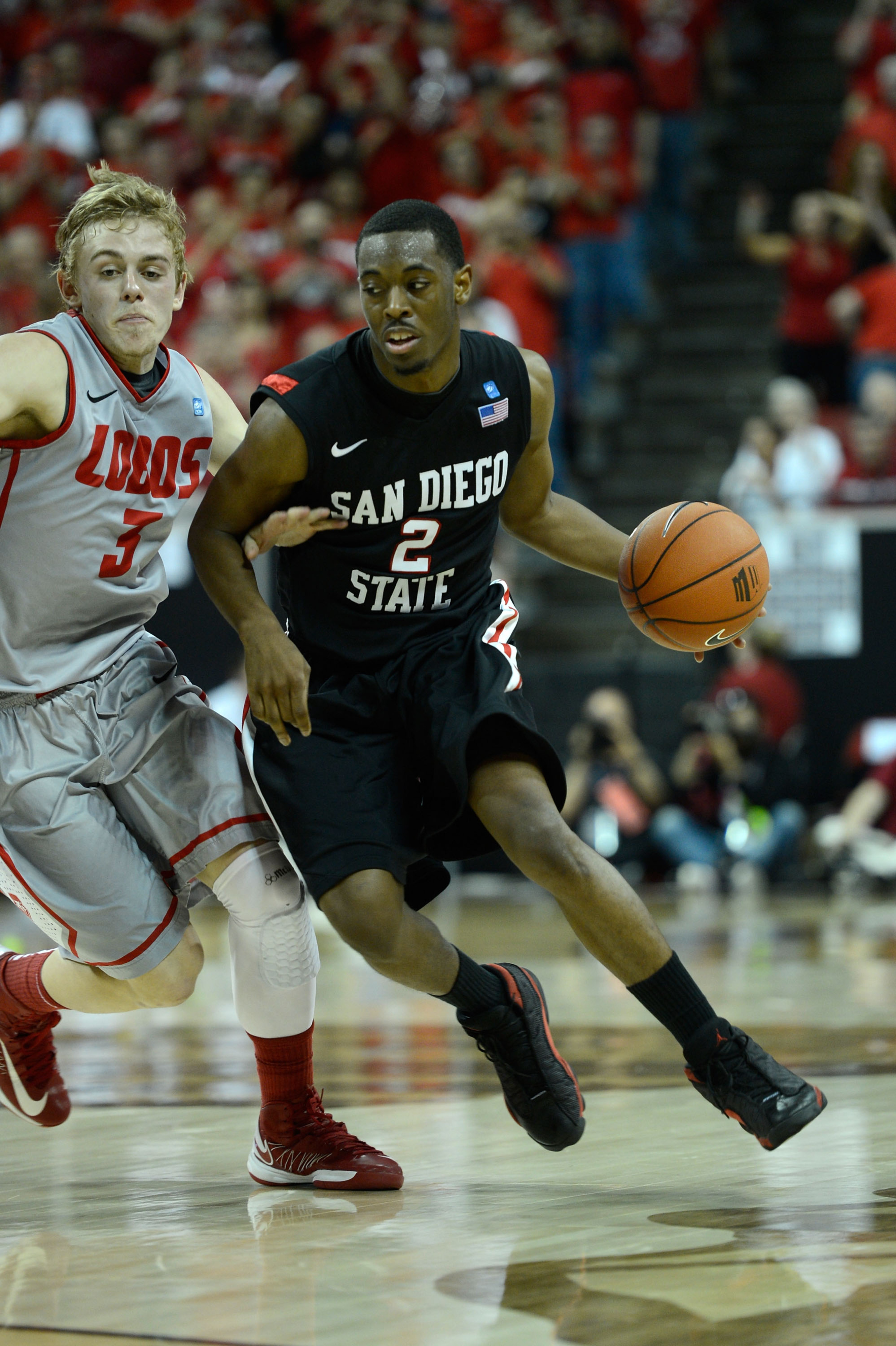 San Diego State and New Mexico battle for first place.