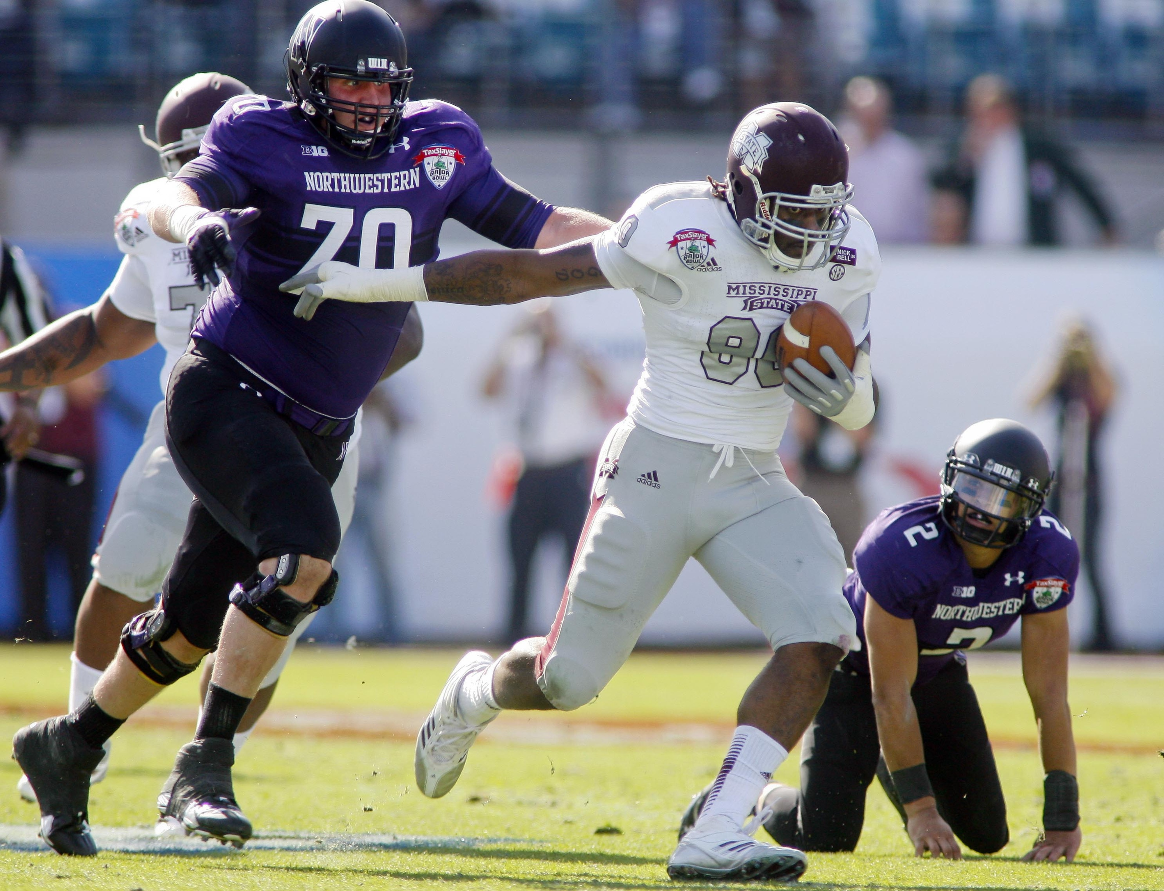 Patrick Ward using his knowledge of angles to chase down a Mississippi State player, while an ingrateful Kain Colter sits helpless on his knees because of his selfishness/inferior engineering background