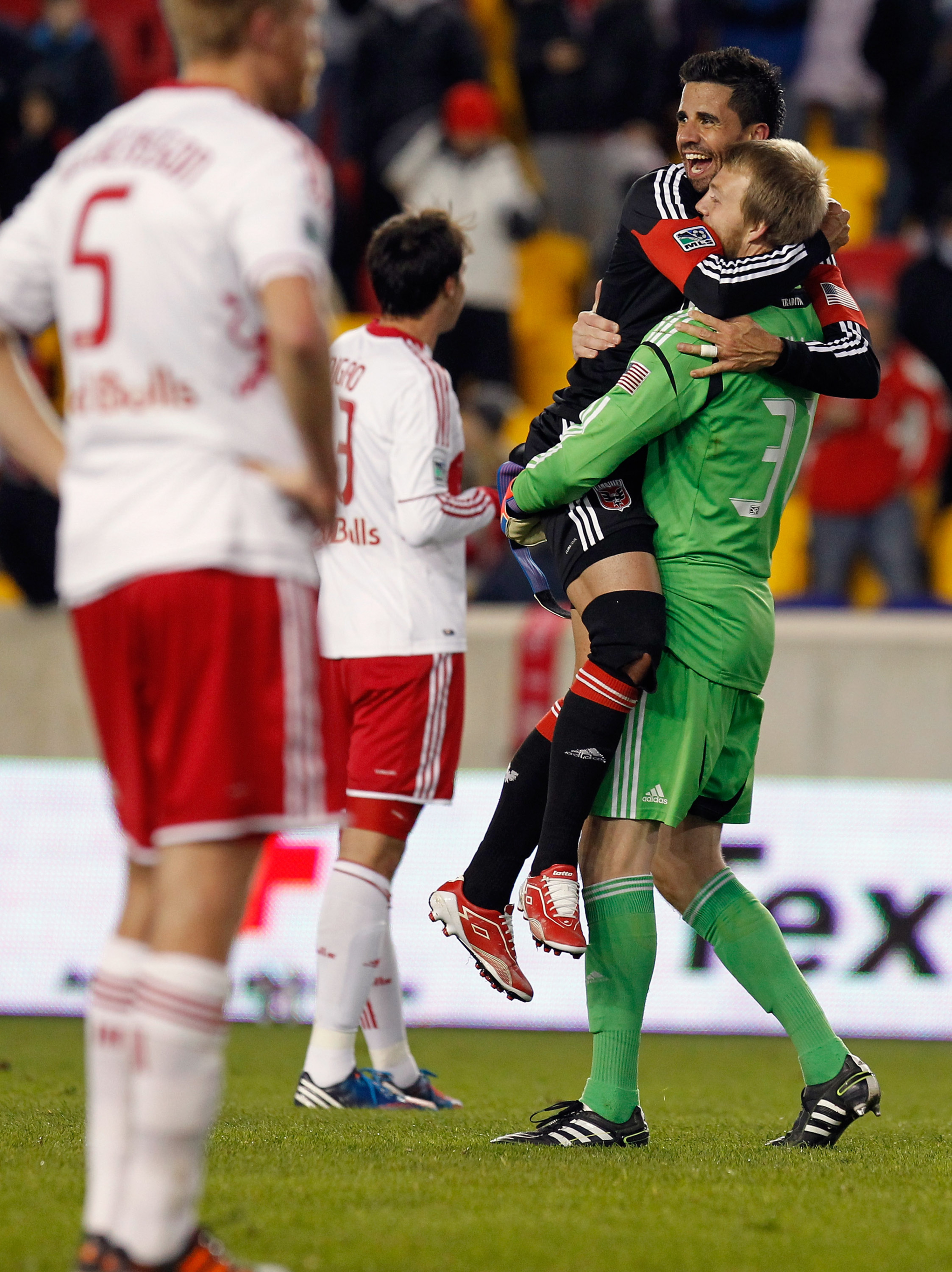 Members of DC United celebrate after Thursday's victory.