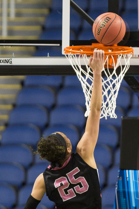 Dearica Hamby dislodges a basketball that came to rest on the heel of the rim