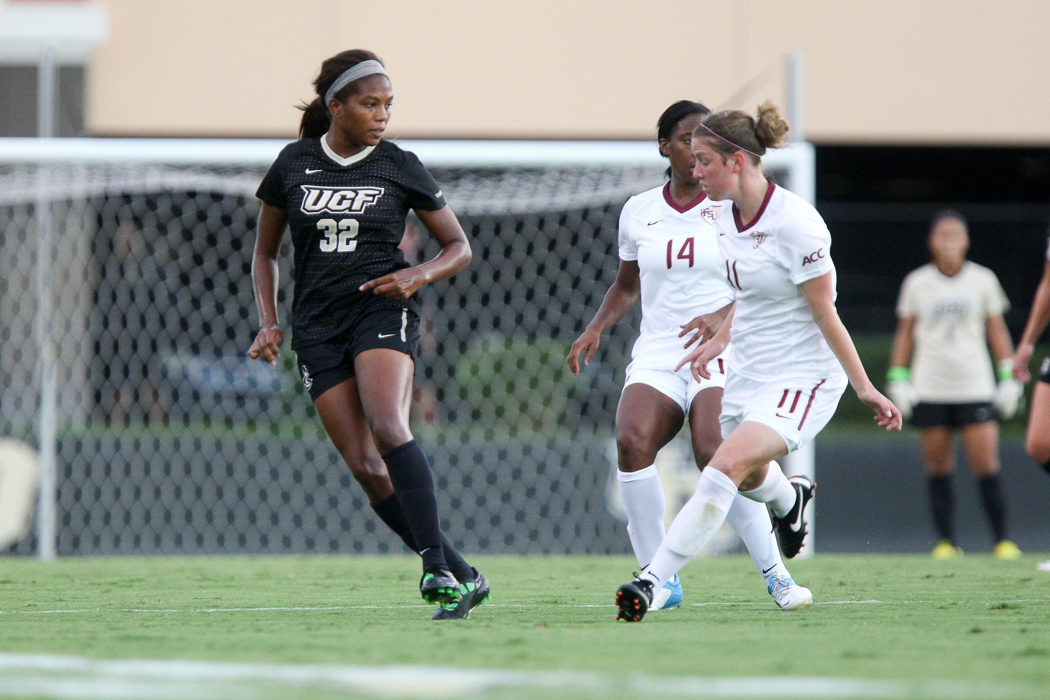 Defender Marissa Diggs Takes on FSU players.