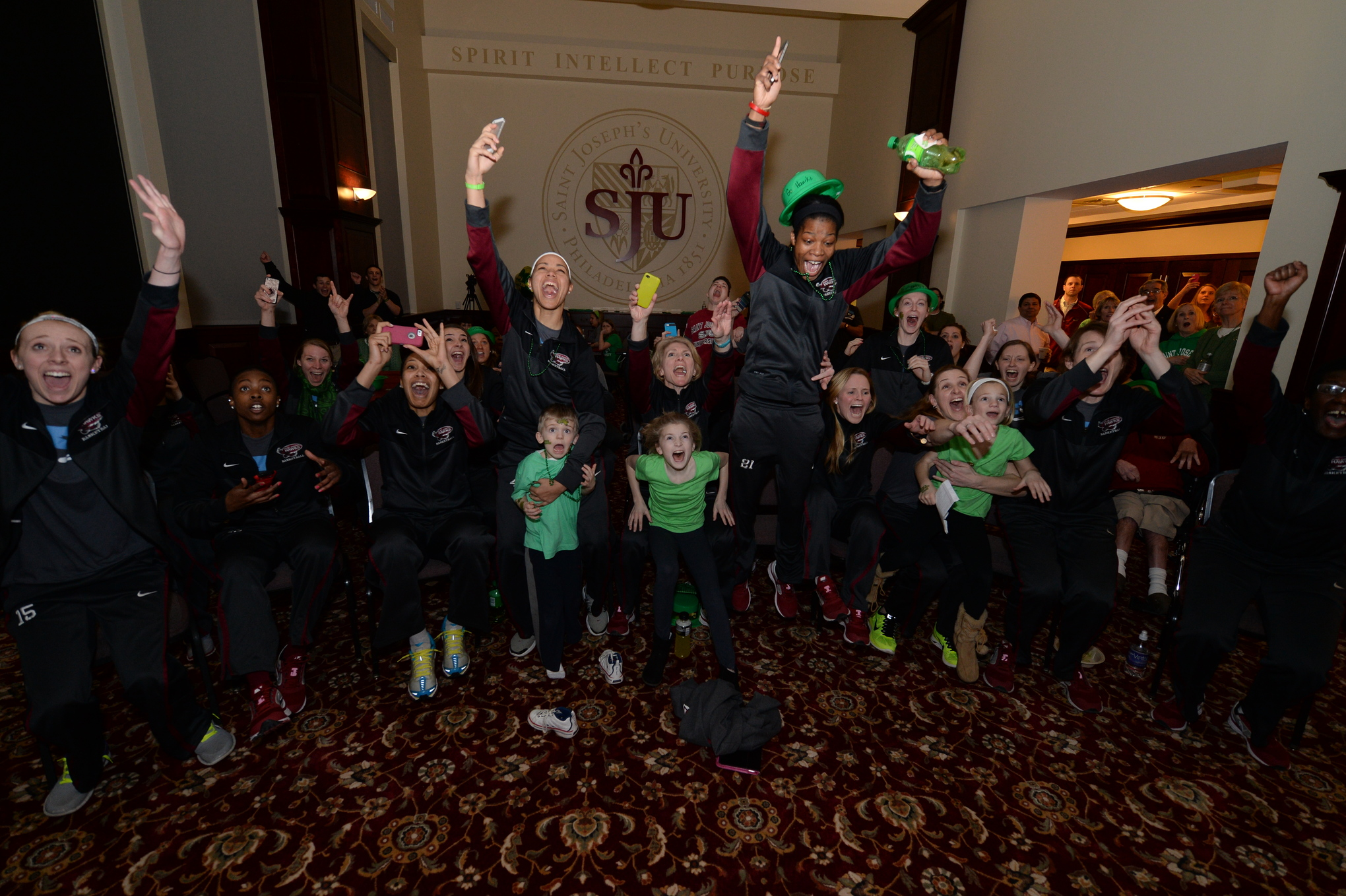 St. Joseph's celebrates after learning they had made the 2014 NCAA Tournament.