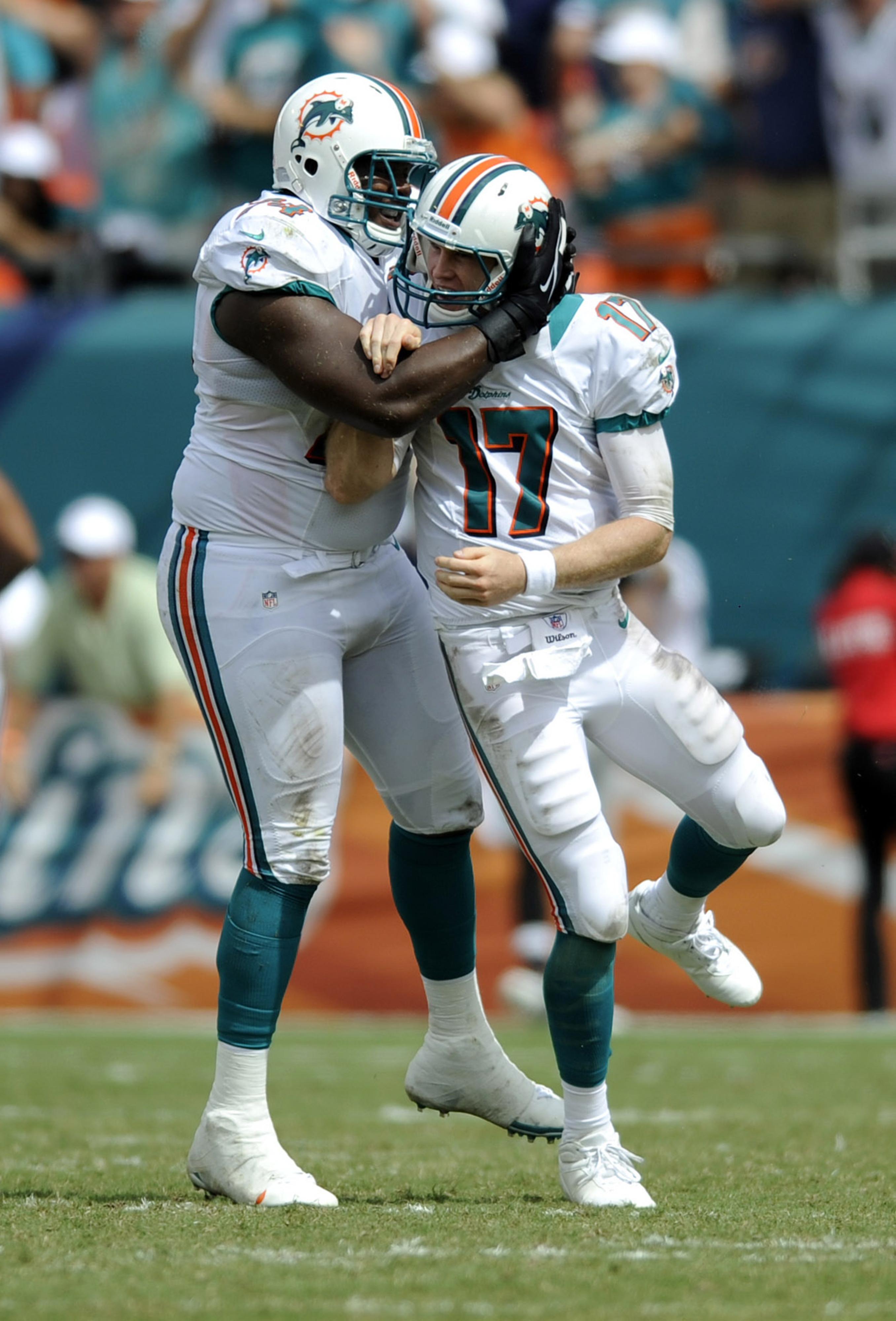 John Jerry celebrates with Miami quarterback Ryan Tannehill