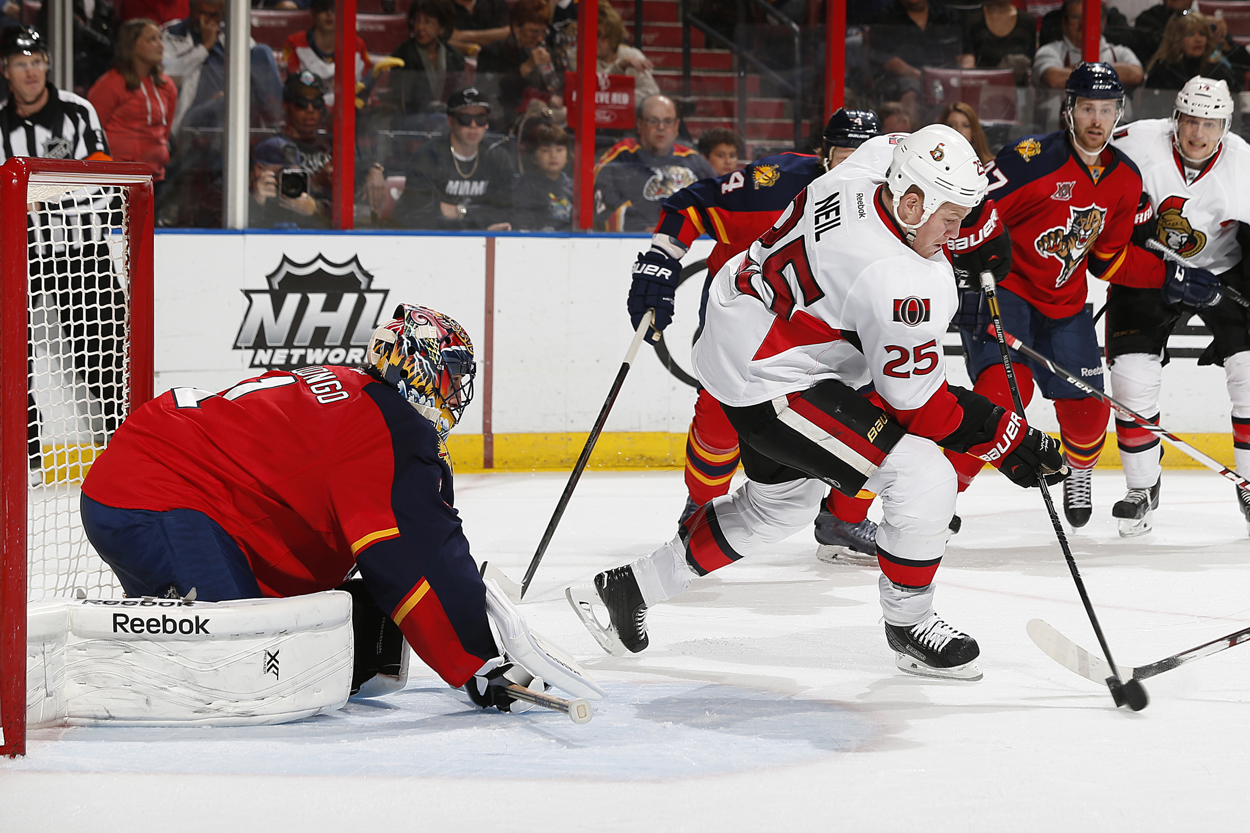 Chris Neil fires a puck past Roberto Luongo ... no, not really.