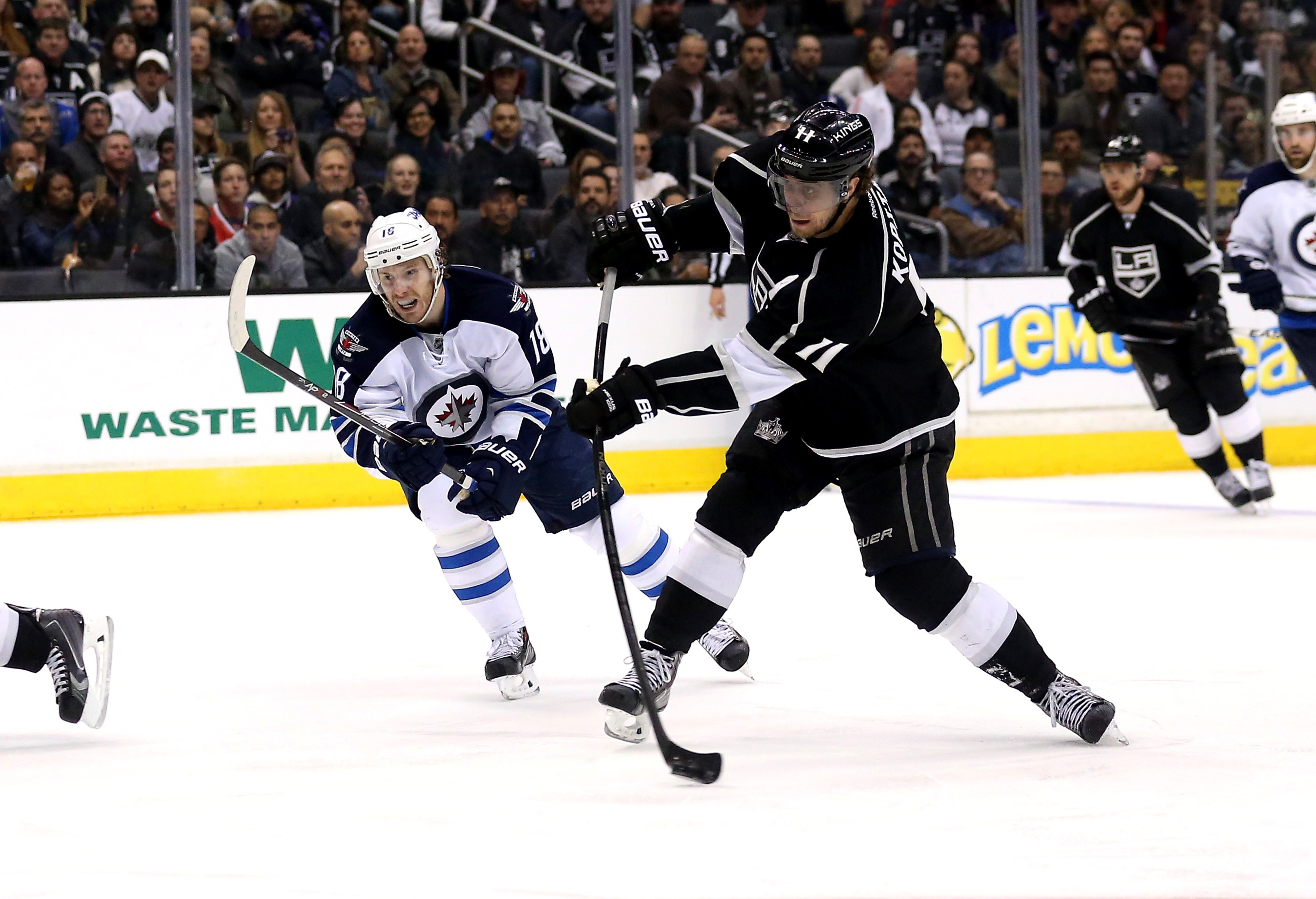 Kings #11 Anze Kopitar takes a shot while Jets #18 Bryan Little tries to defend at Staples Centre on March 29th