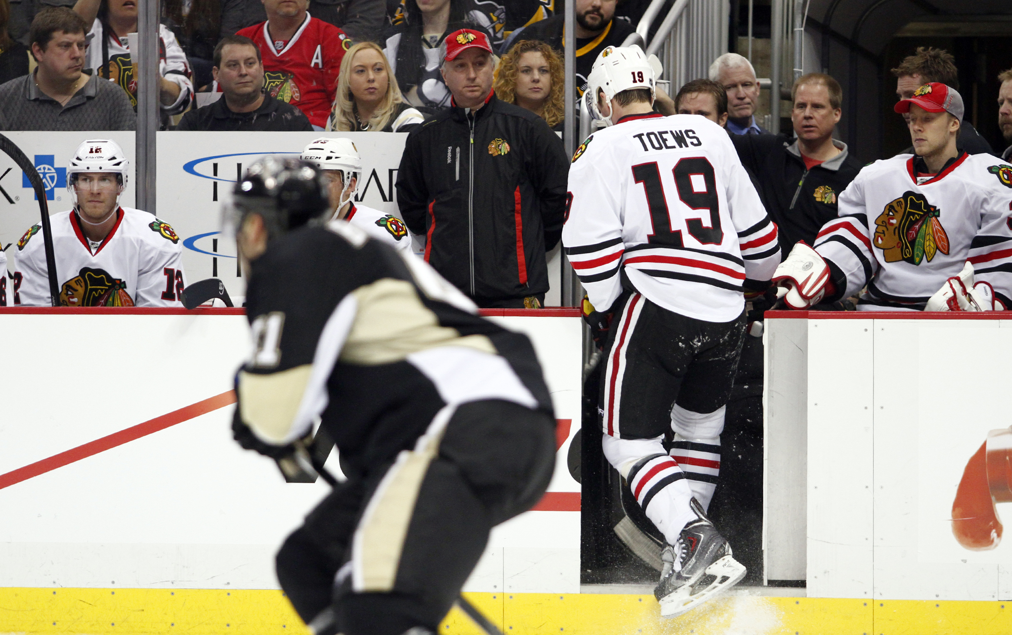 Toews leaves the game after injuring his arm from a Brooks Orpik check.