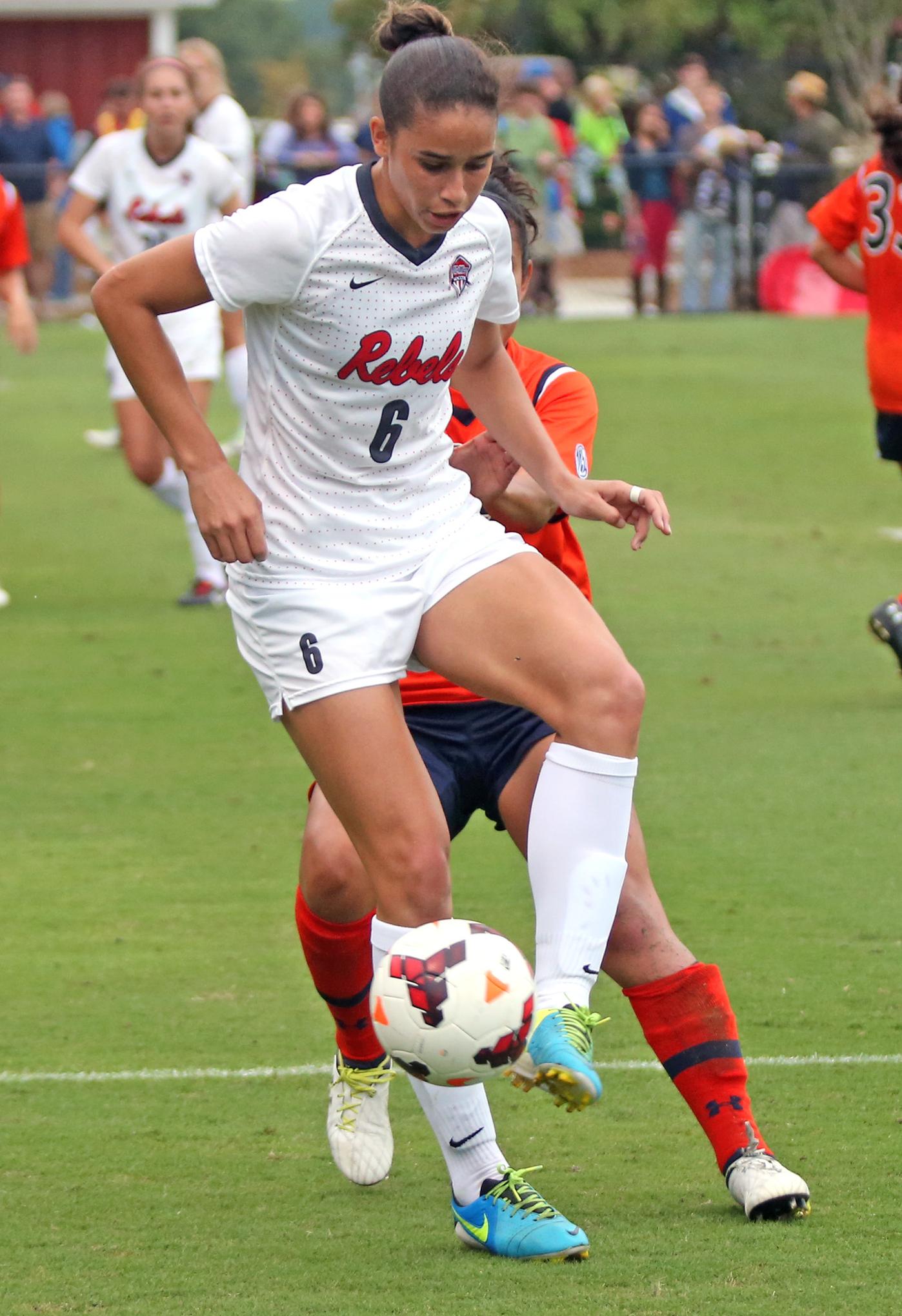 Rafaelle Souza gets the ball past Auburn.