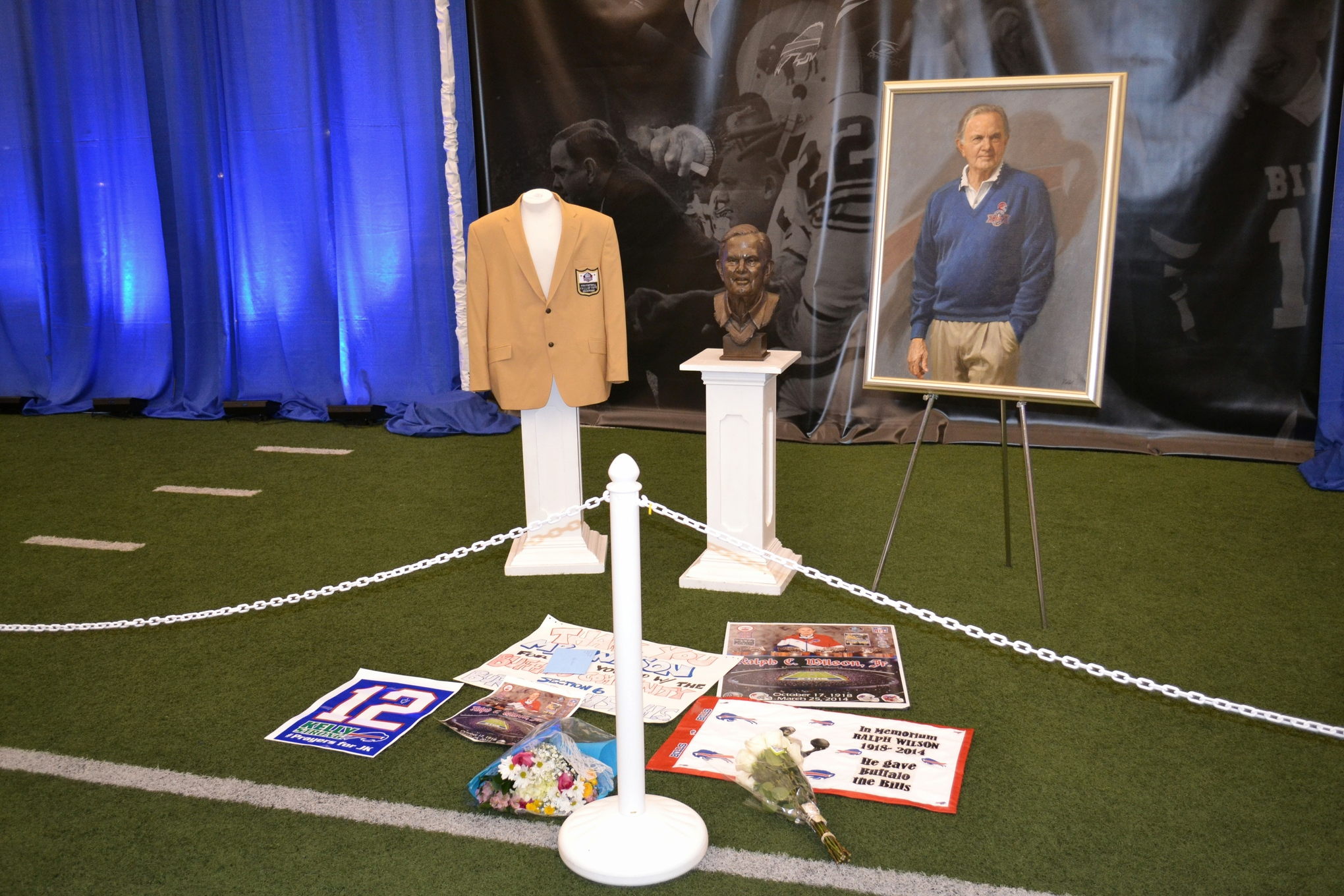 Gifts left for Buffalo Bills owner Ralph C. Wilson at his memorial. April 5, 2014.
