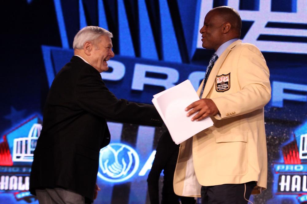 Moon shaking hands with former Pittsburgh Steeler Jack Butler,