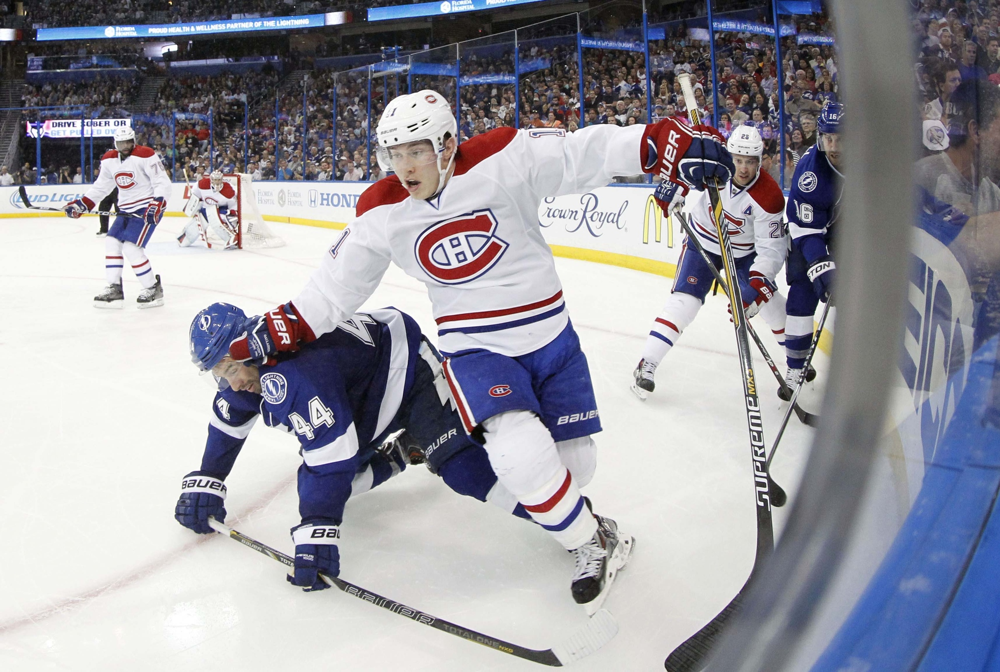 The Lightning's Nate Thompson tries to impede Montreal's Brendan Gallagher during the second period of Wednesday's playoff action at the Tampa Bay Times Forum
