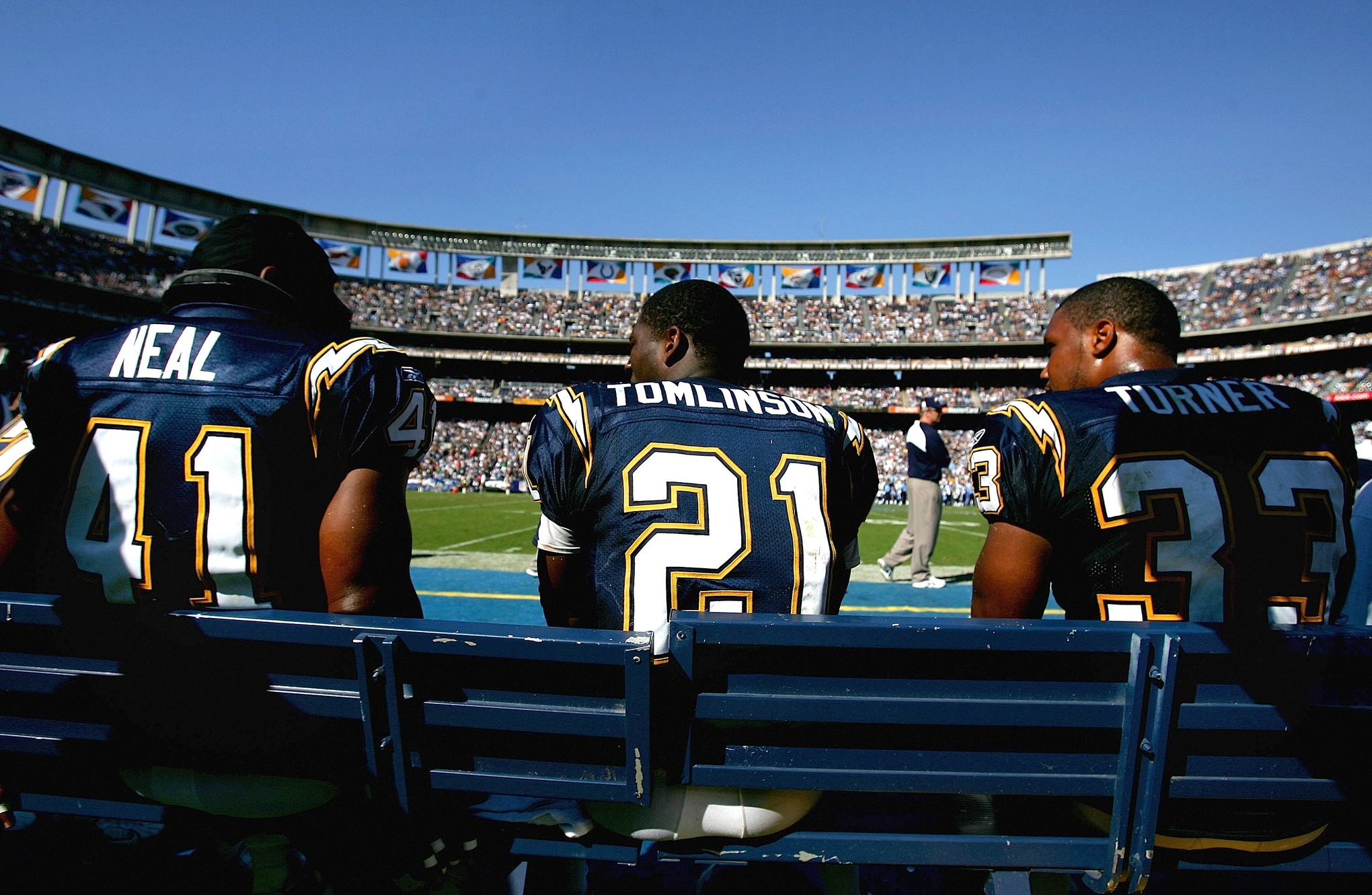 (L-R) Running backs Lorenzo Neal #41, LaDainian Tomlinson #21 and Michael Turner #33 of the San Diego Chargers talk on the bench during the game against the Tennessee Titans September 17, 2006 at Qualcomm Stadium in San Diego, California.