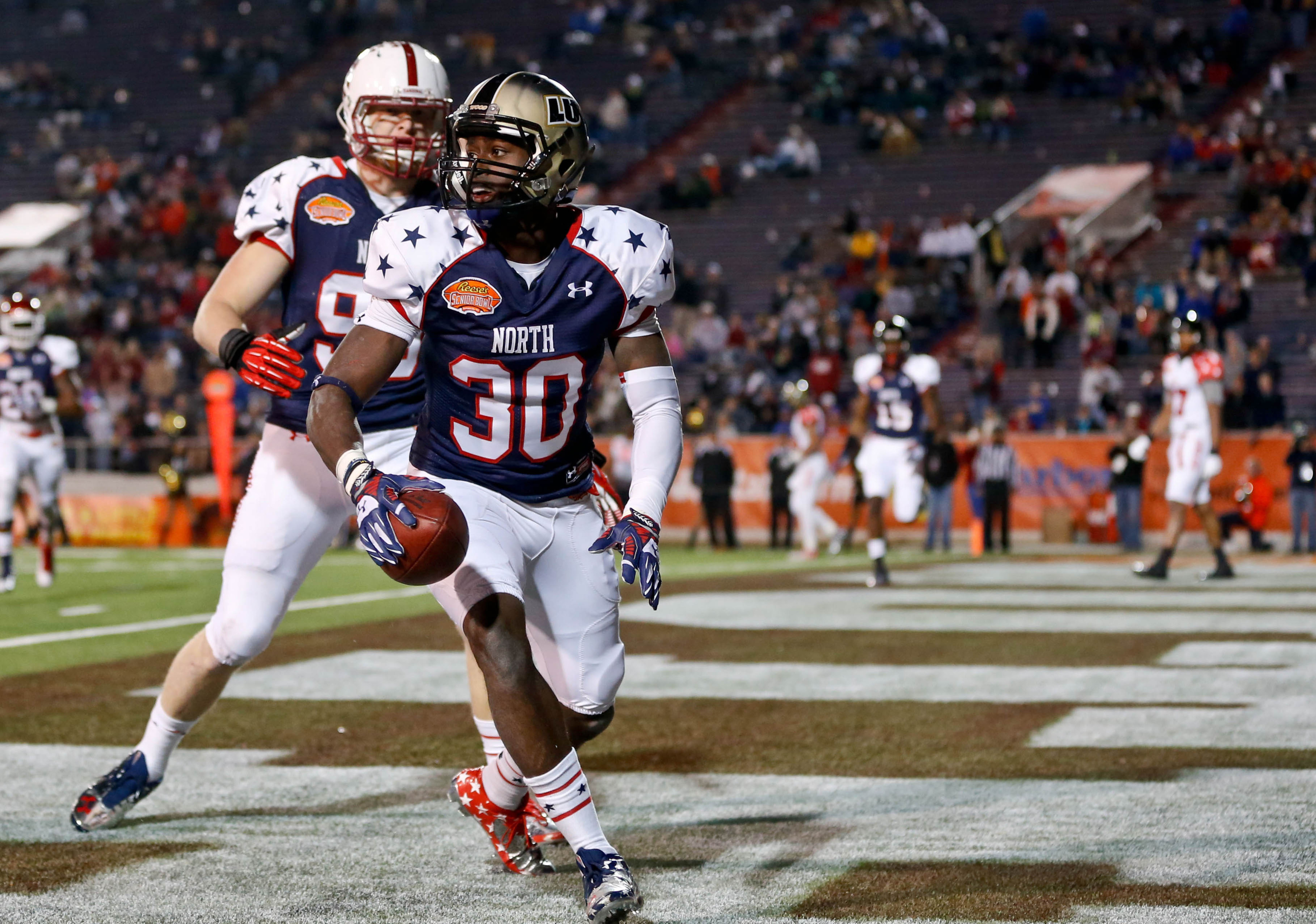 Desir celebrates returning an interception for a touchdown