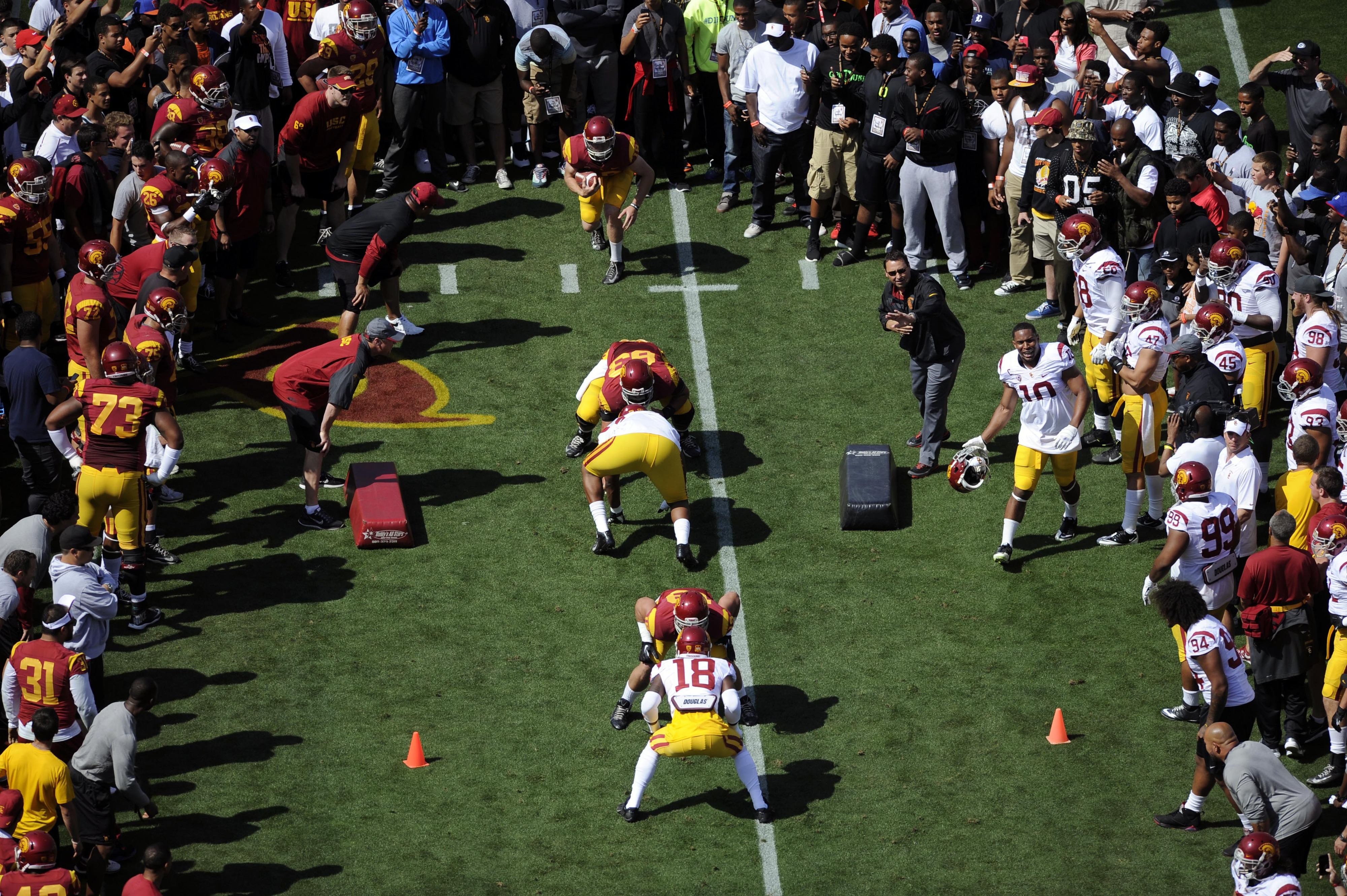 USC players go through drills before their spring game, which concludes spring camp.