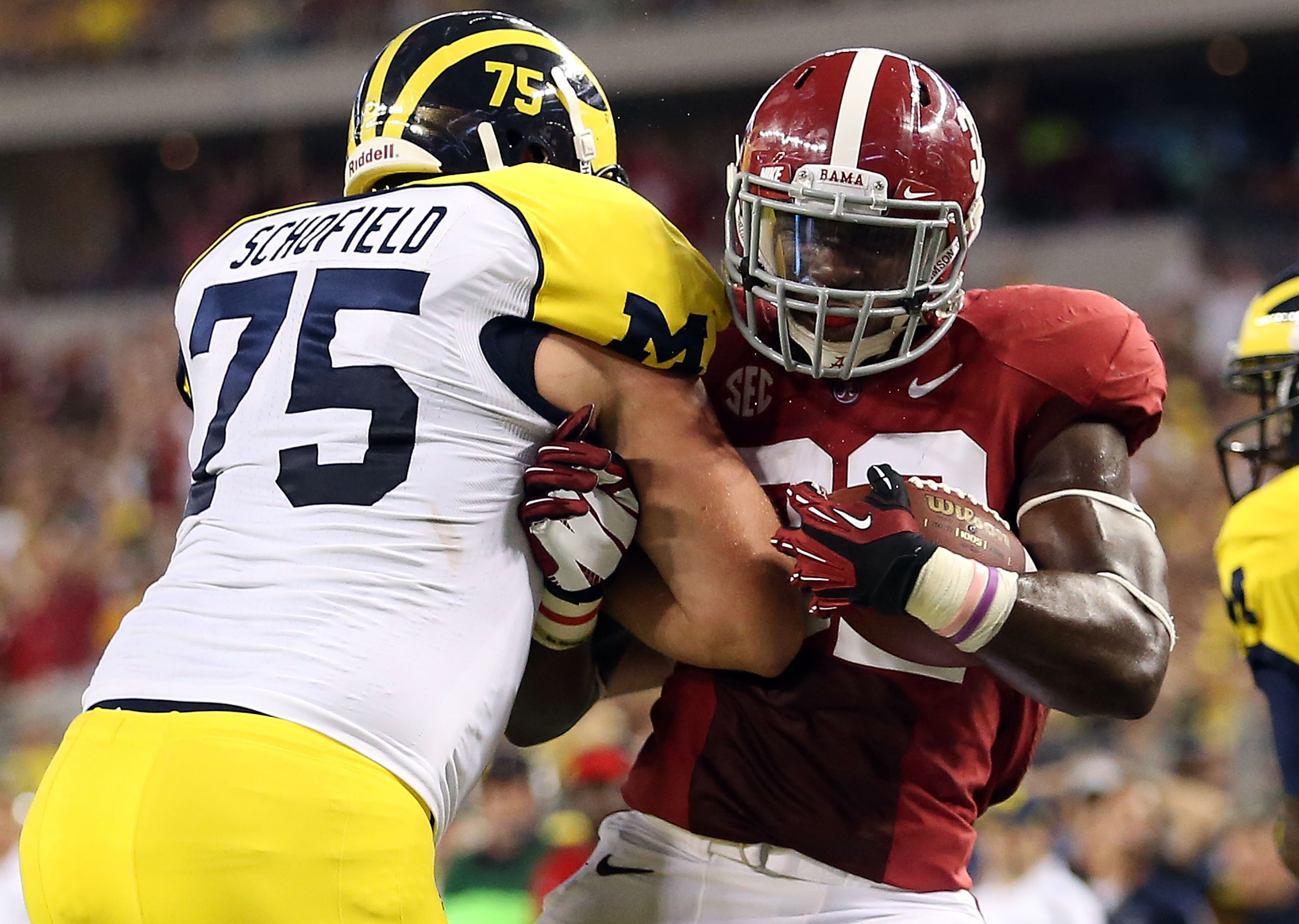 This is the best photo of Michael Schofield, where the offensive lineman is trying to tackle Alabama linebacker C.J. Mosley.