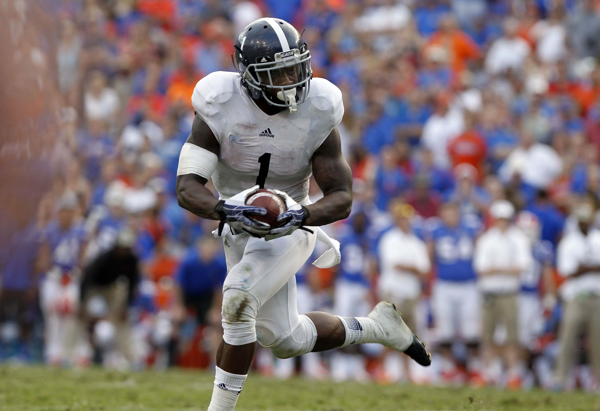 Nov 23, 2013; Gainesville, FL, USA; Georgia Southern Eagles quarterback/running back Jerick McKinnon (1) runs the ball in for the game winning touchdown against the Florida Gators during the second half at Ben Hill Griffin Stadium. Georgia Southern E