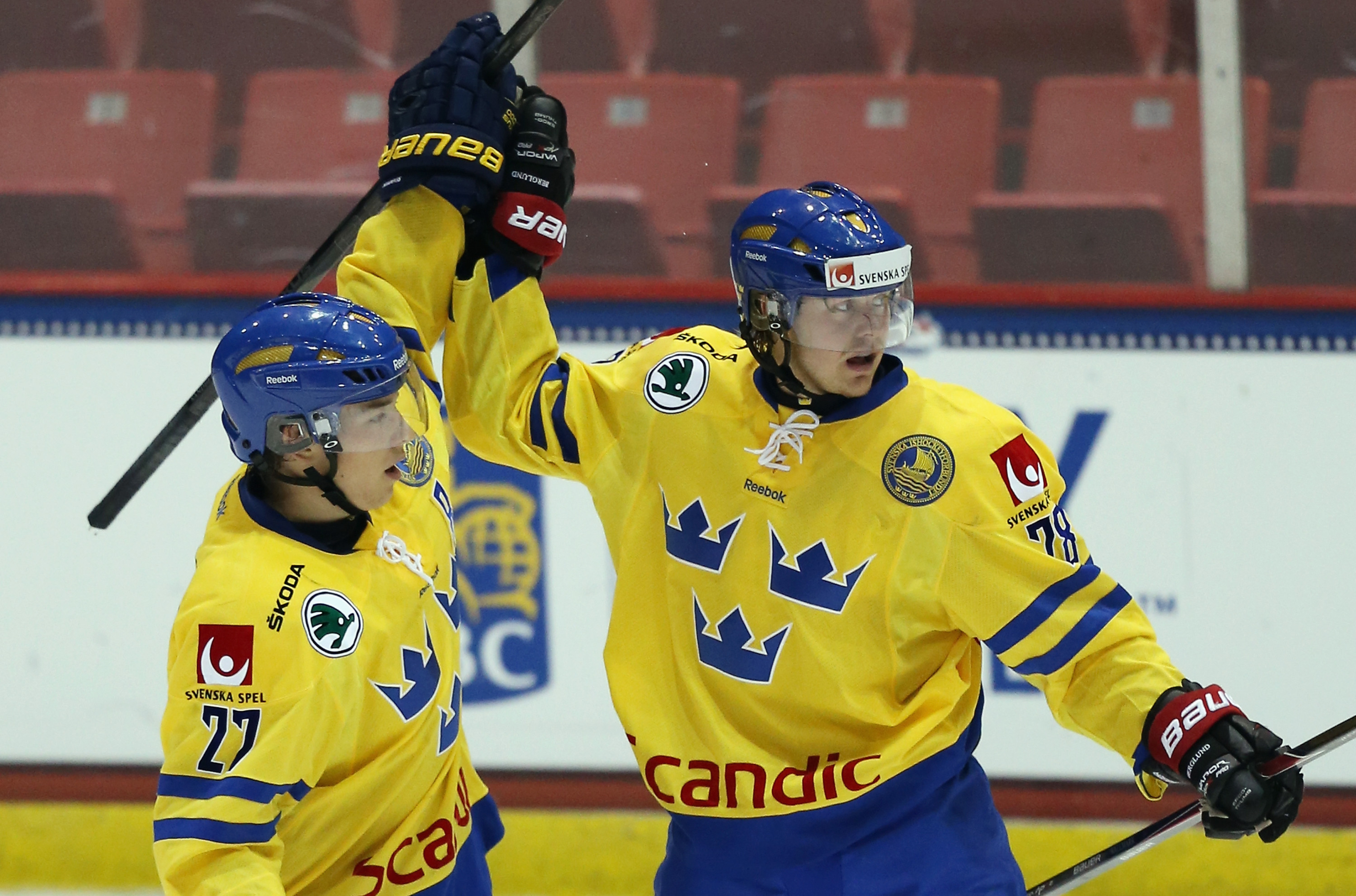 Lucas Wallmark (right) celebrates with Filip Sandberg in an August 2013 exhibition against the US.