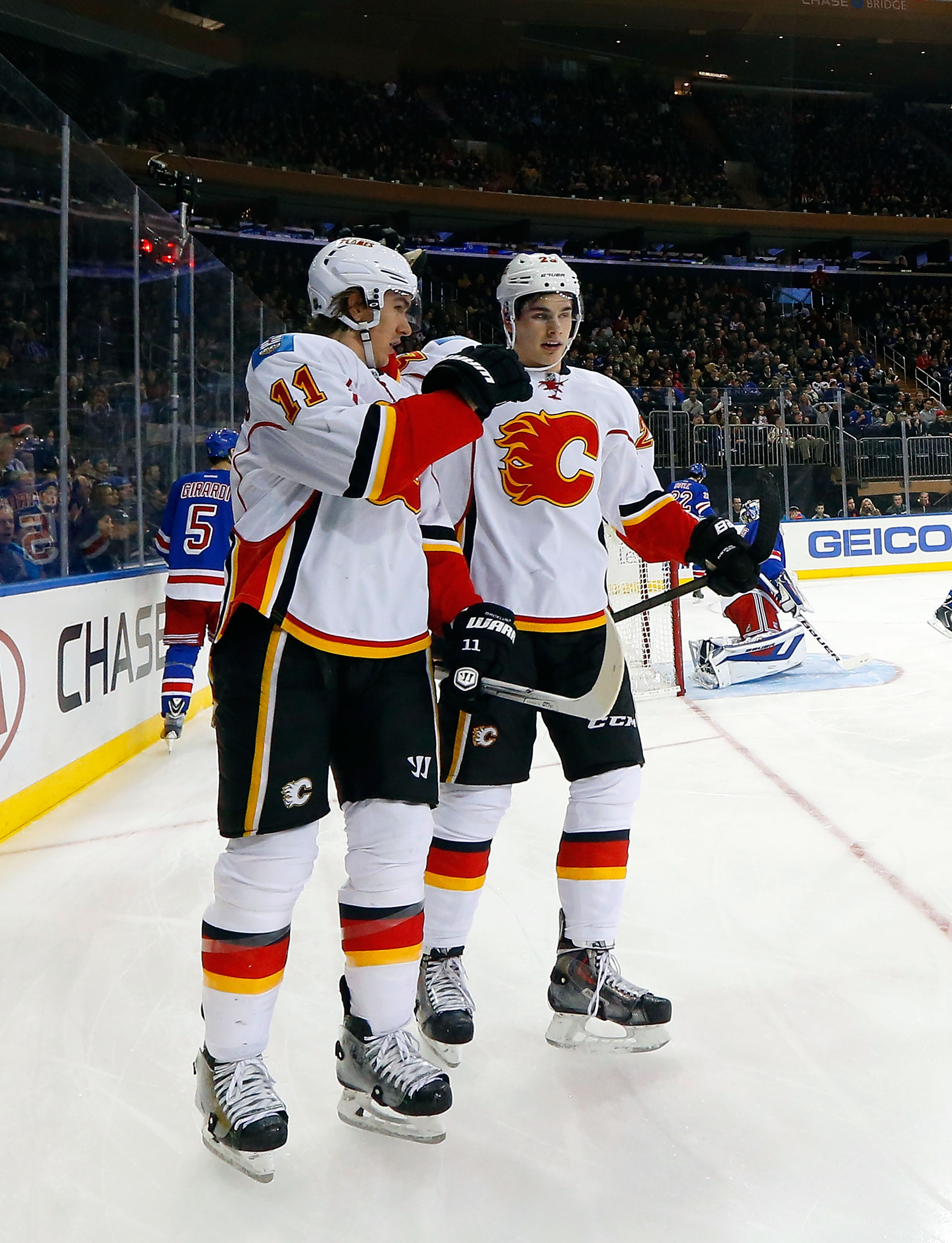 Backlund and Monahan played against each other today, so they weren't wearing the same uniform.
