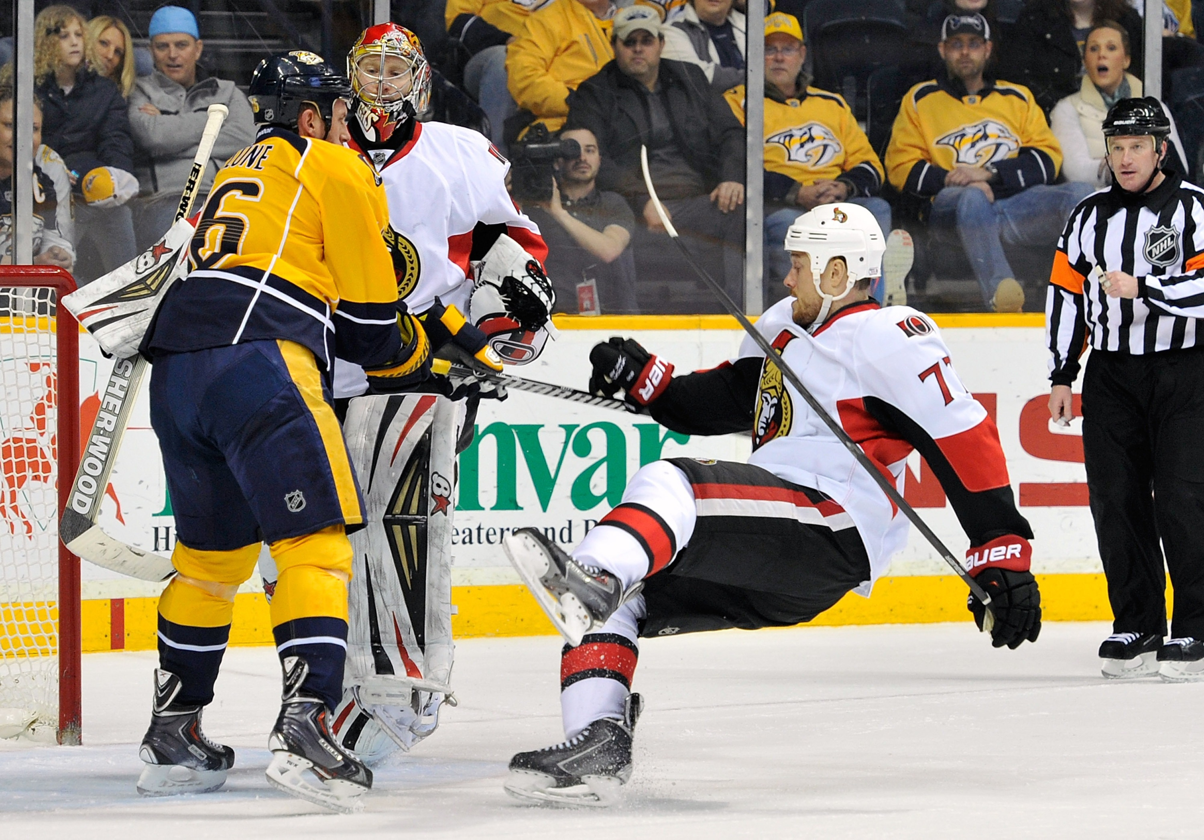 """Oh, hi there Mr. Corvo, I think you dropped something, let me help you."" Rich Clune puts Ottawa Senators forward Joe Corvo on his wallet at Bridgestone Arena on January 11, 2014."