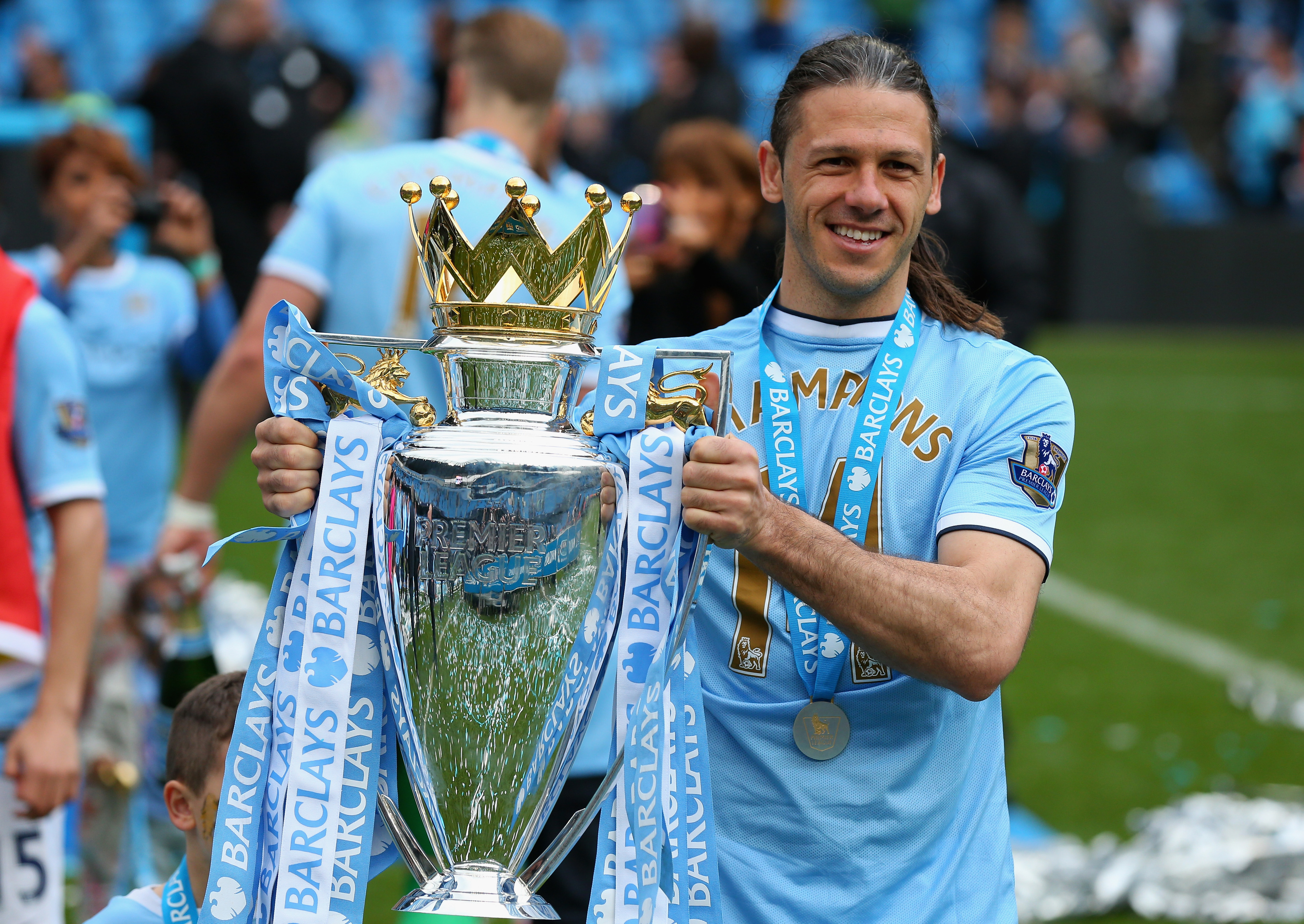 Champion: Martin Demichelis lifts the EPL trophy