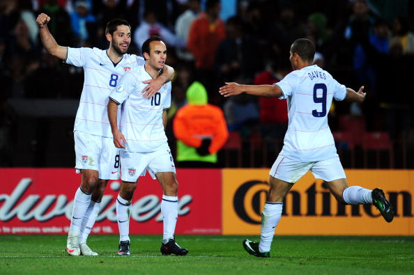 Landon Donovan of USA celebrates scoring his team's second goal with team mates Clint Dempsey and Charlie Davies during the 2009 FIFA Confederations Cup Final.