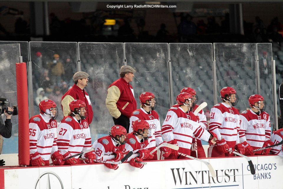 Assistant coach Gary Shuchuk (red jacket, left) will be joined at Wisconsin by his son, Alex.