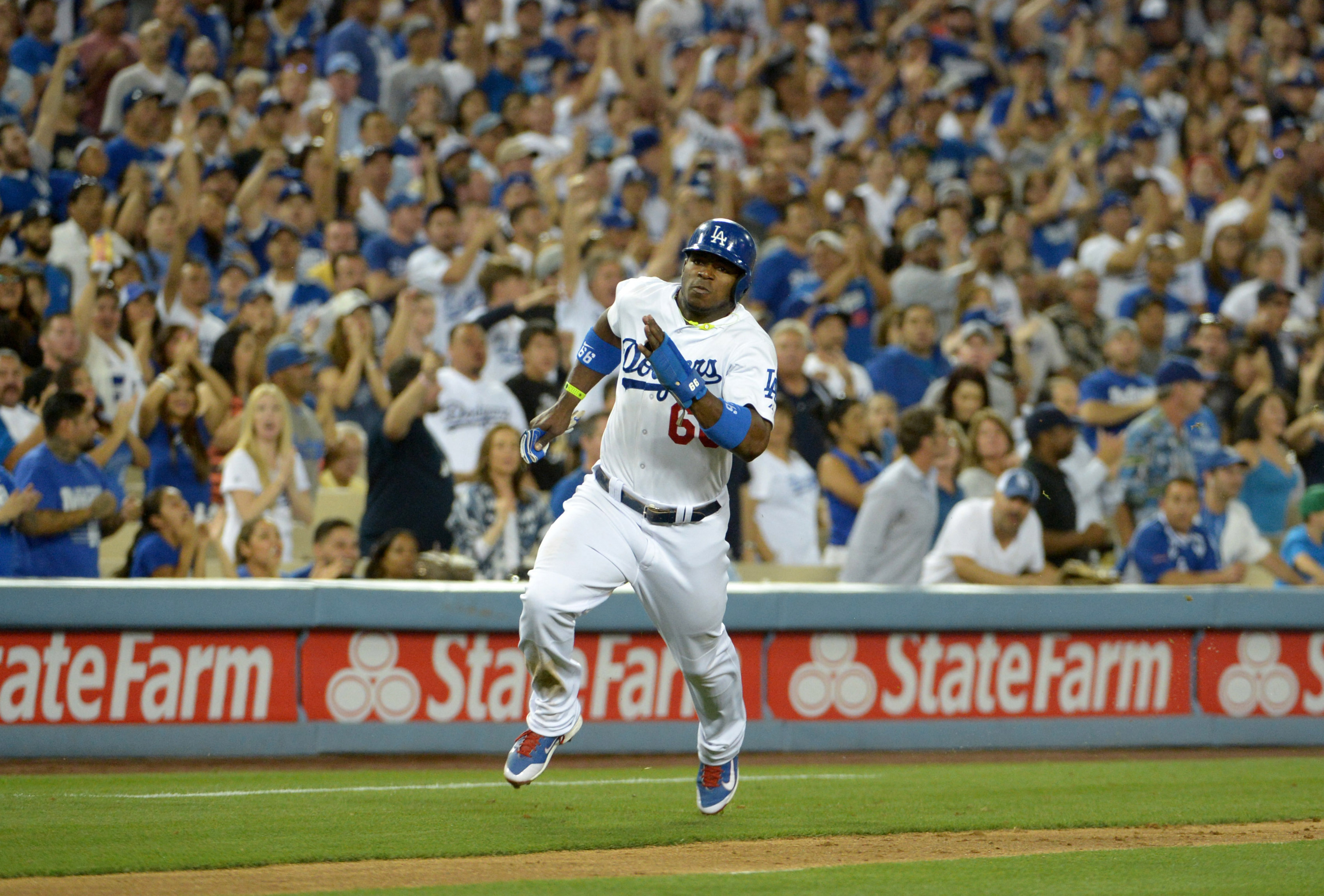 High flying Yasiel Puig heads home on his first year as a Dodgers and gets ready to start his second.
