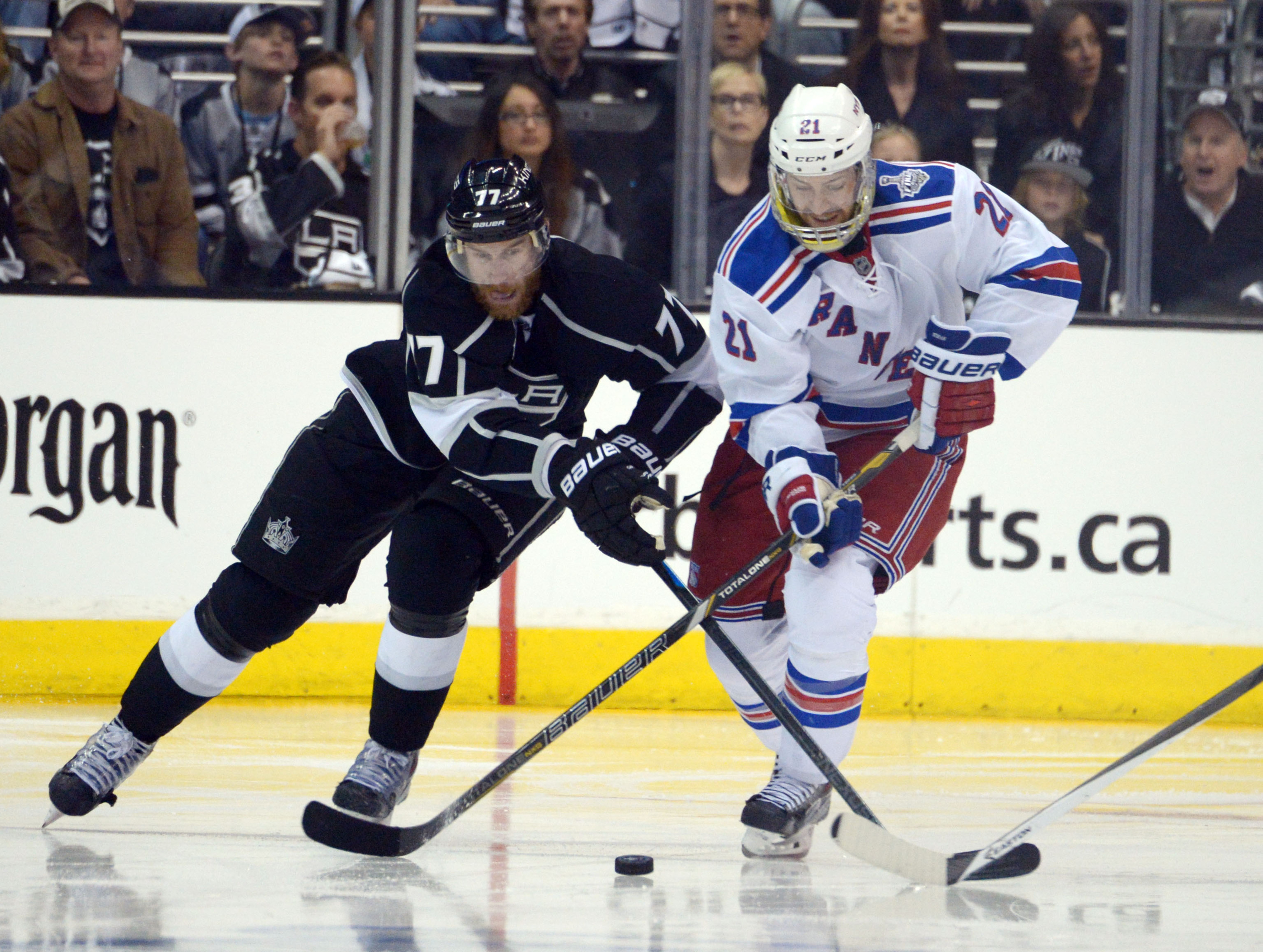 derek stepan tries to learn how to hockey from an actually good player