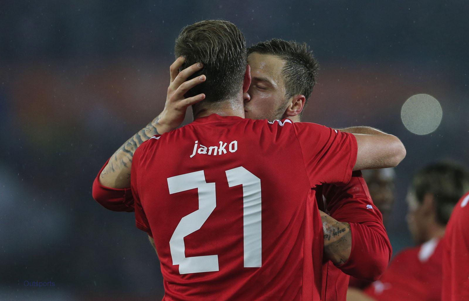 Austria's Marko Arnautovic (right) congratulates teammate Marc Janko.