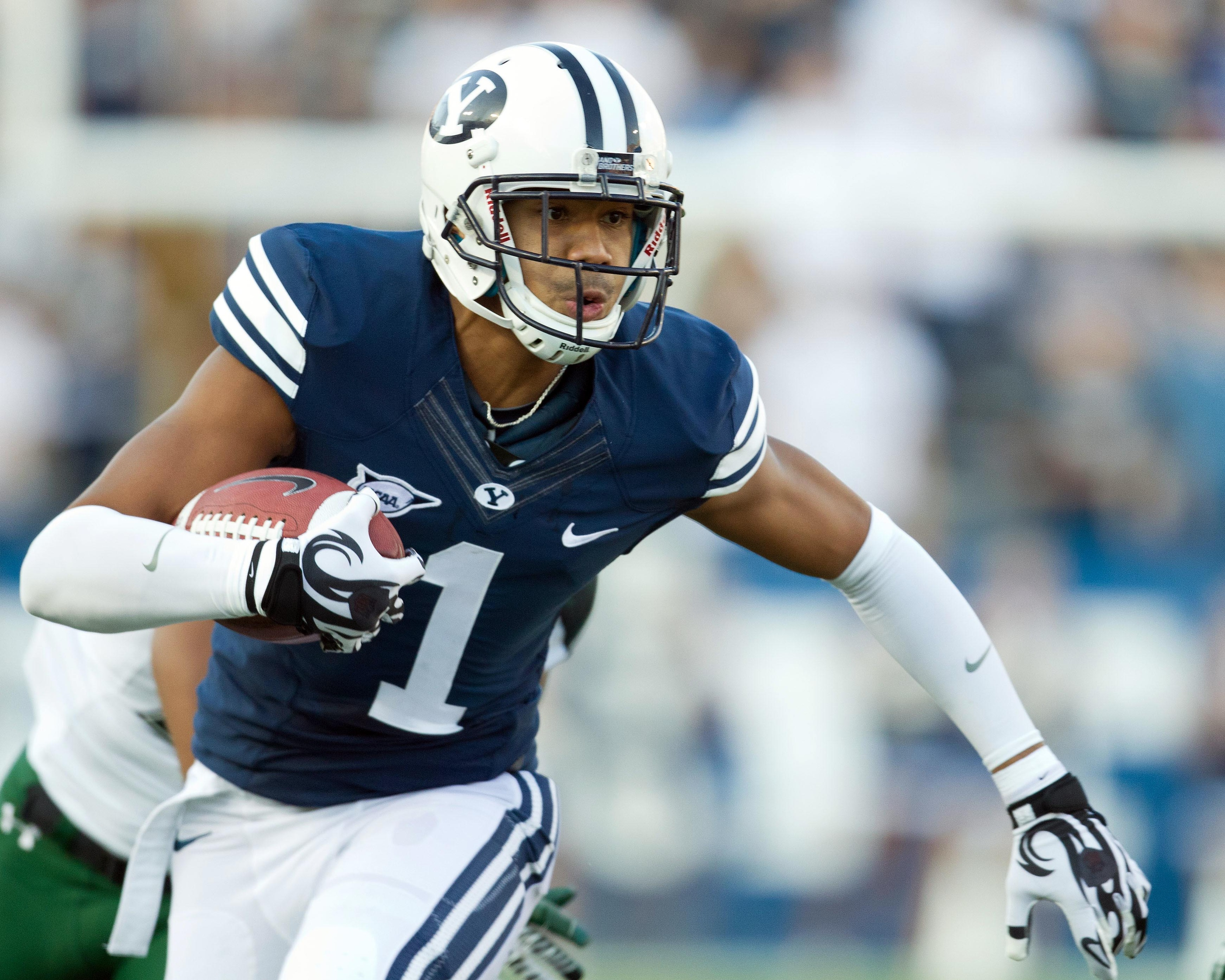September 28, 2012; Provo, UT, USA; Brigham Young Cougars wide receiver Ross Apo (1) runs after a catch during the first quarter against the Hawaii Warriors at Lavell Edwards Stadium. Mandatory Credit: Russ Isabella-US PRESSWIRE