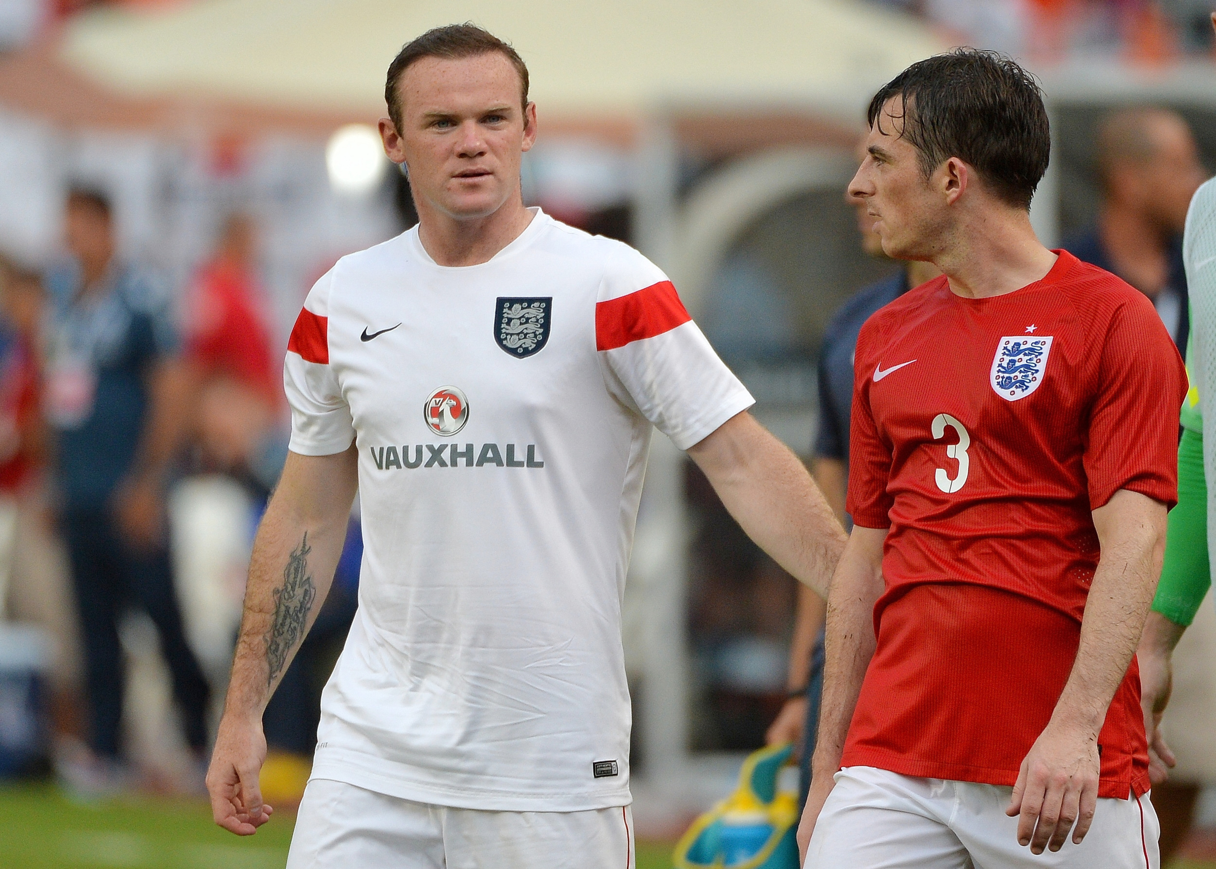 Leighton Baines and Wayne Rooney lead England against Italy today.