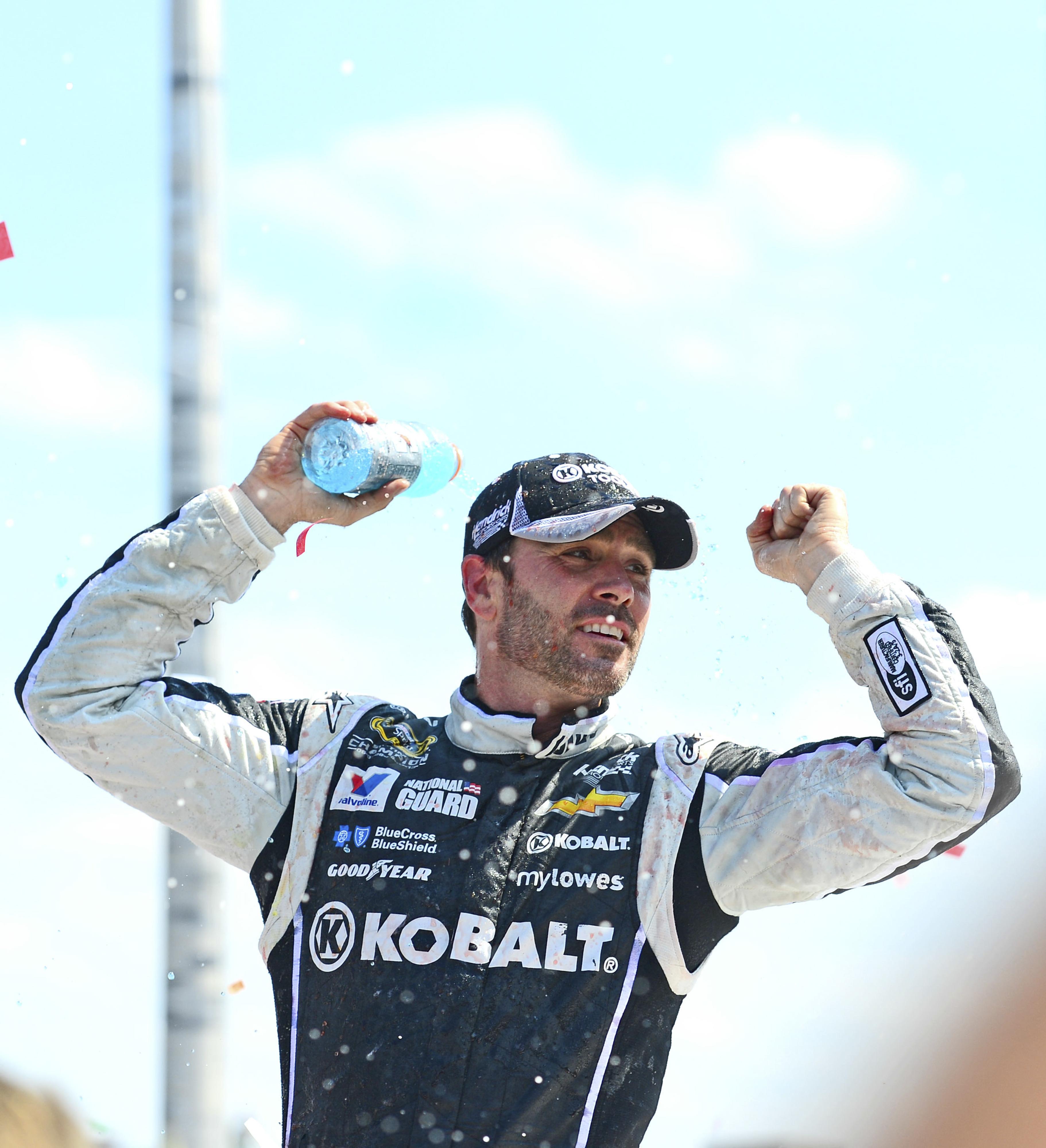 Jimmie Johnson wins the 2014 Quicken Loans 400 at Michigan International Speedway