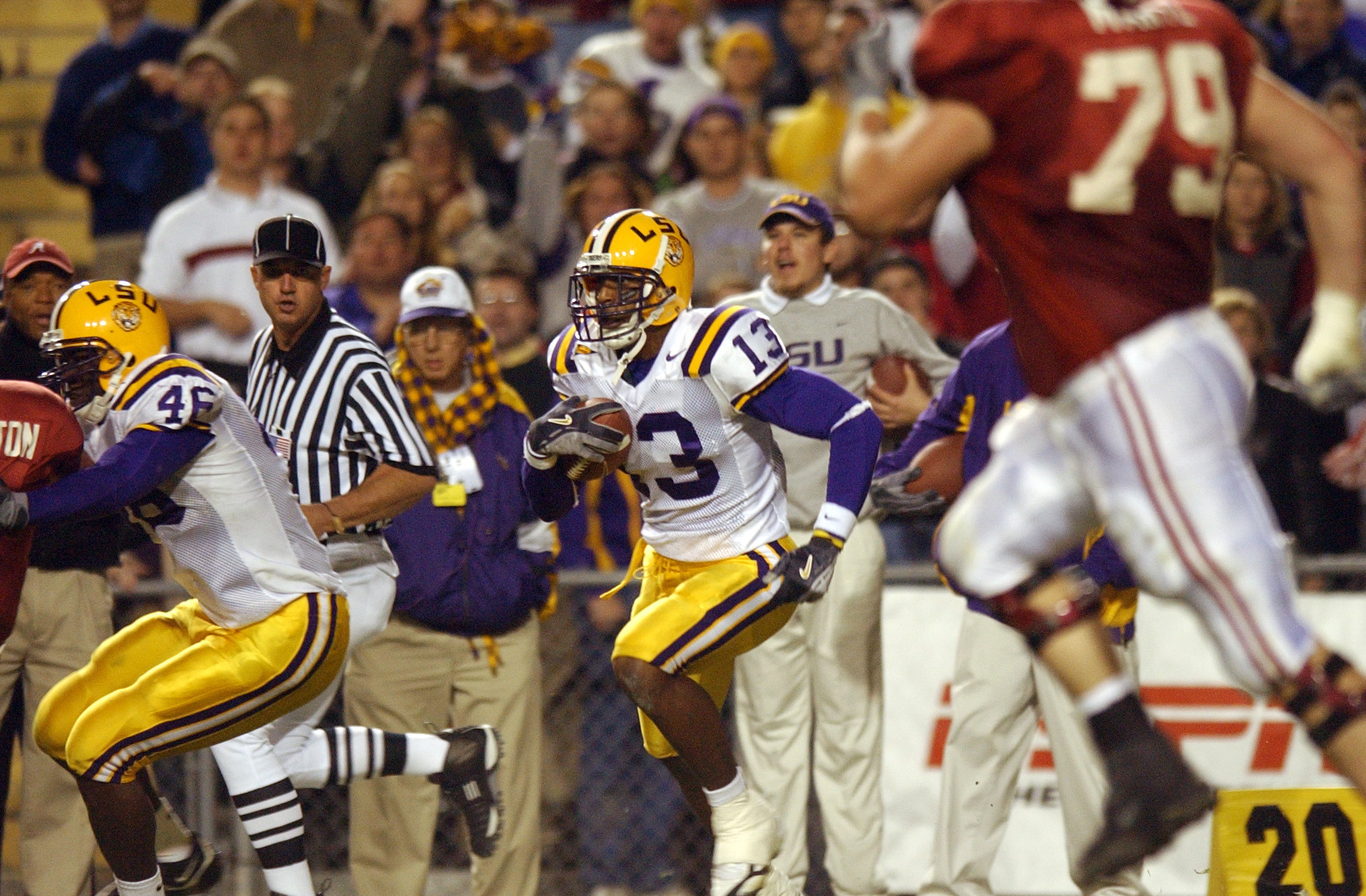 Corey Webster #13 wide receiver of the Louisiana State University Tigers runs the ball upfield