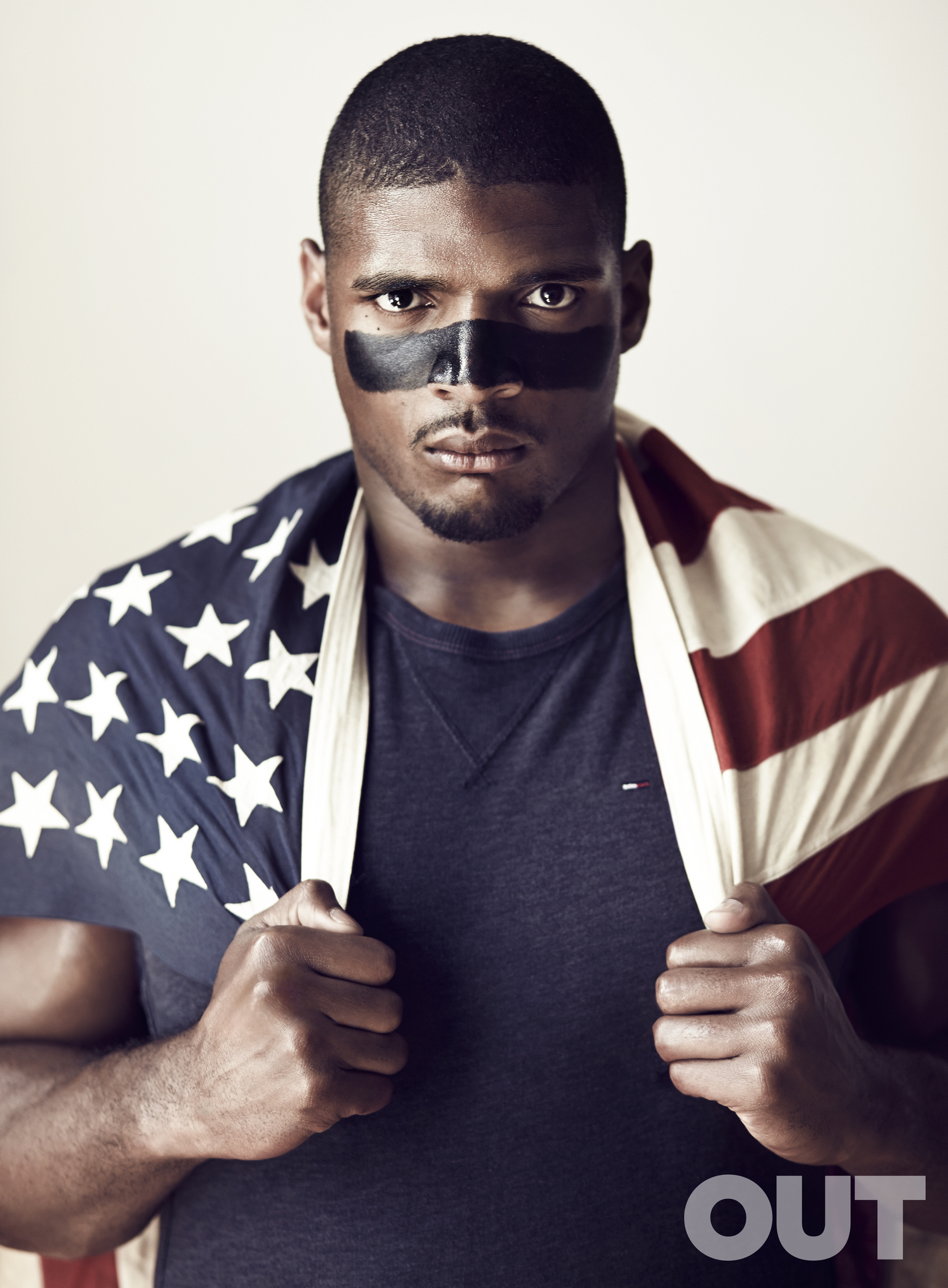 Michael Sam graces the cover of Out magazine's August 2014 sports issue.