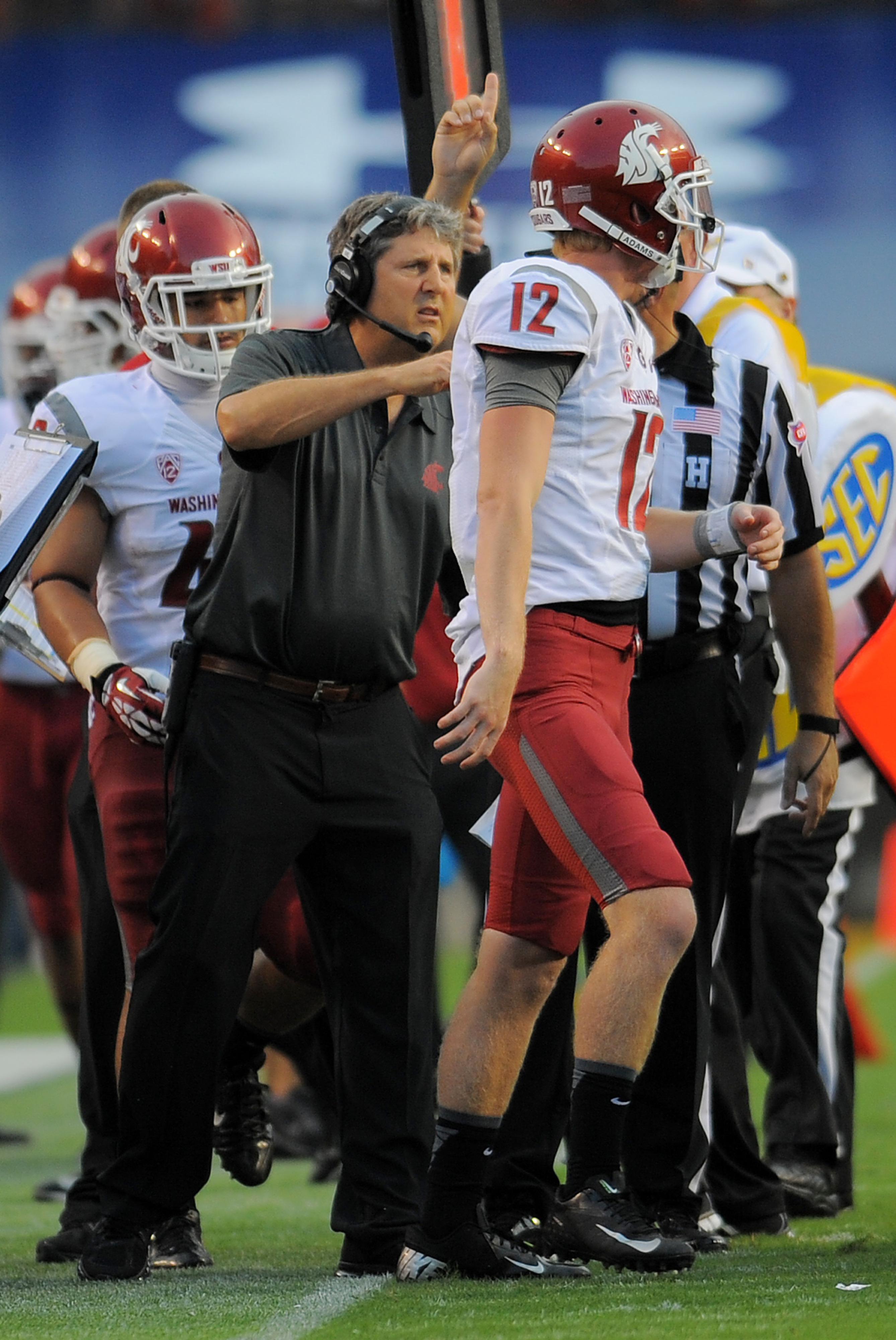 Washington State head coach Mike Leach brings quarterback Connor Halliday (12) and the Air Raid offense to Rice-Eccles Stadium on Sept. 27.