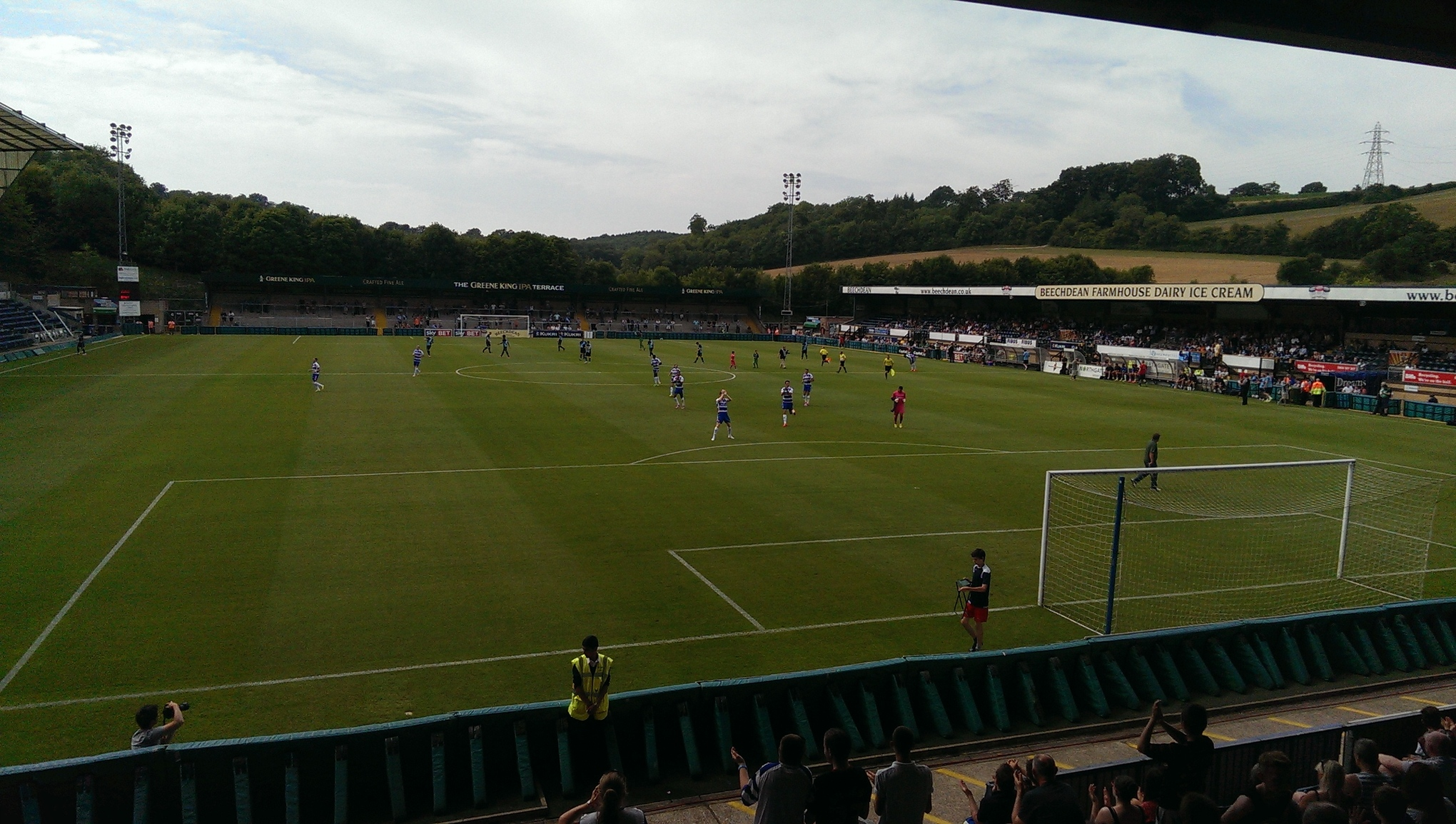 The players take to the pitch at Adams Park