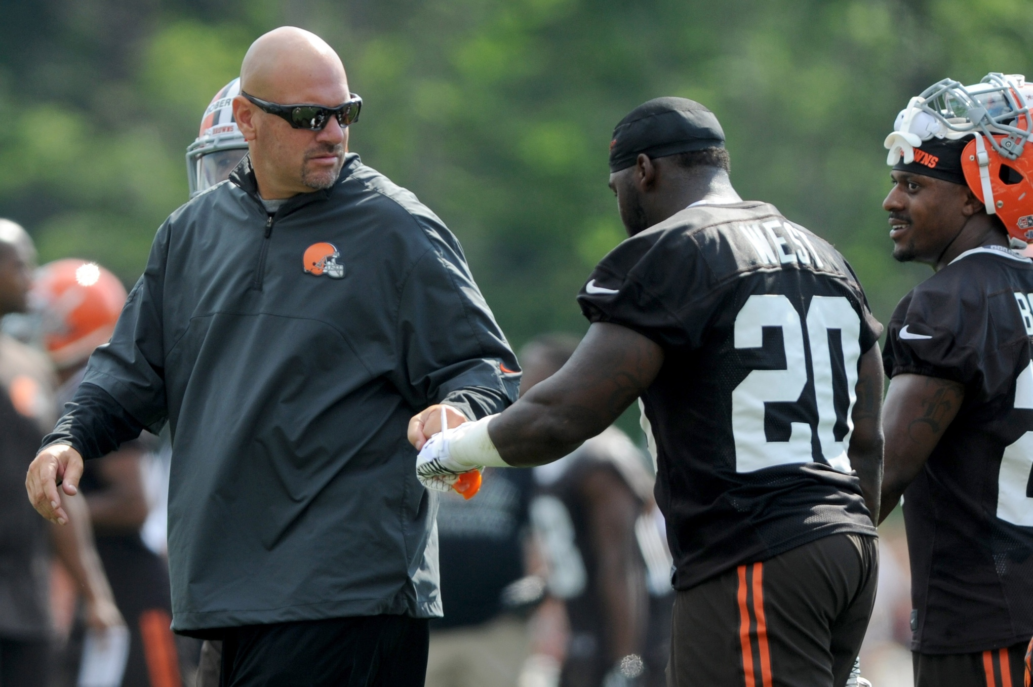 Berea, OH, USA; Cleveland Browns head coach Mike Pettine bumps fists with Cleveland Browns running back Terrance West (20) during training camp at the Cleveland Browns training facility.