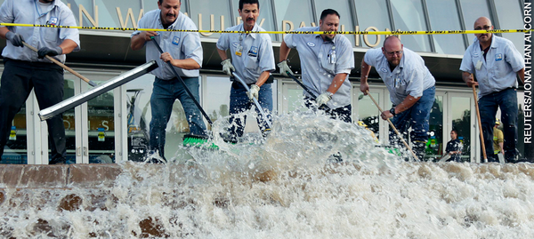 Workers Move Water Out of Pauley Pavilion