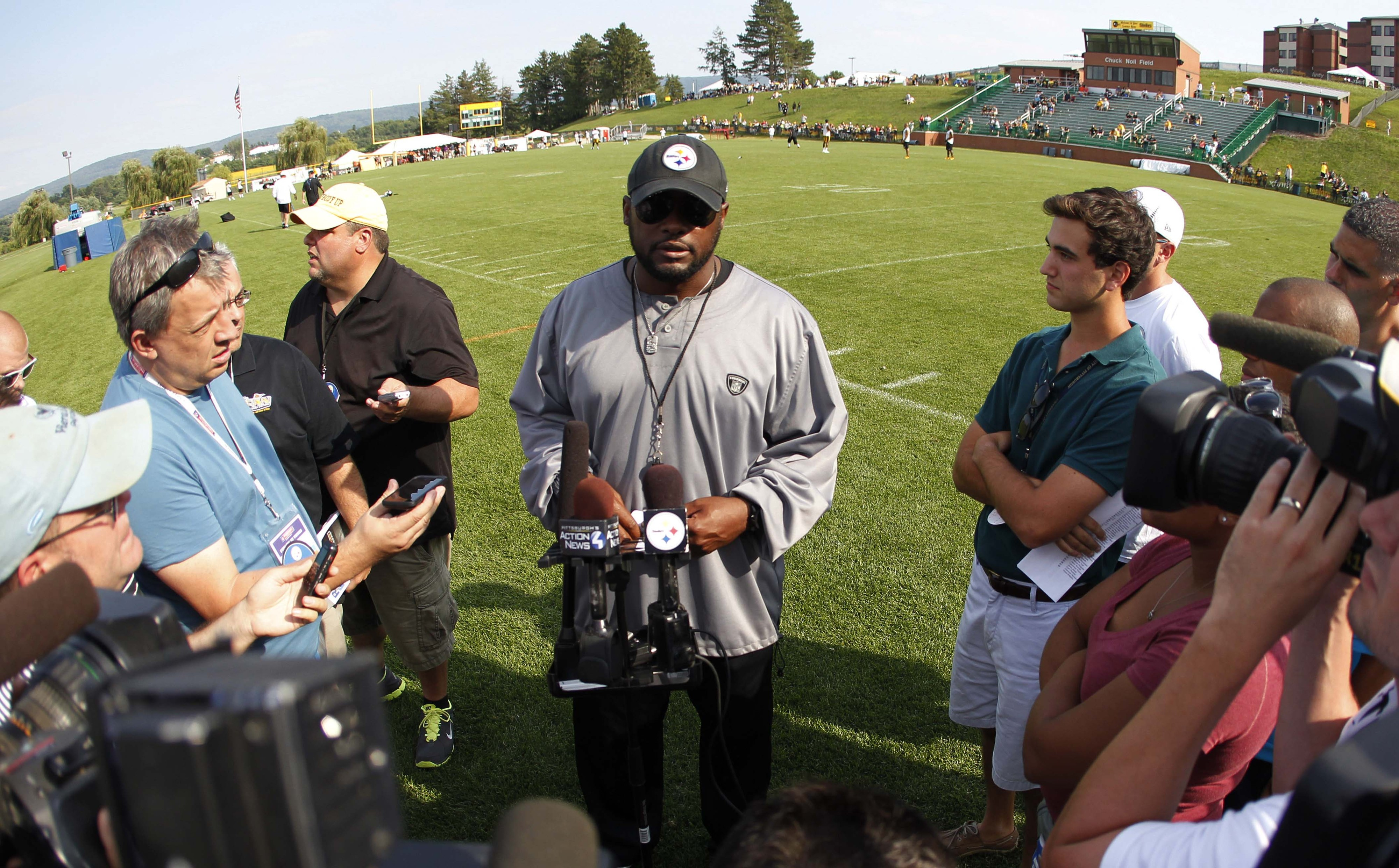 Mike Tomlin addressing the media at Latrobe during Steelers training camp 2014