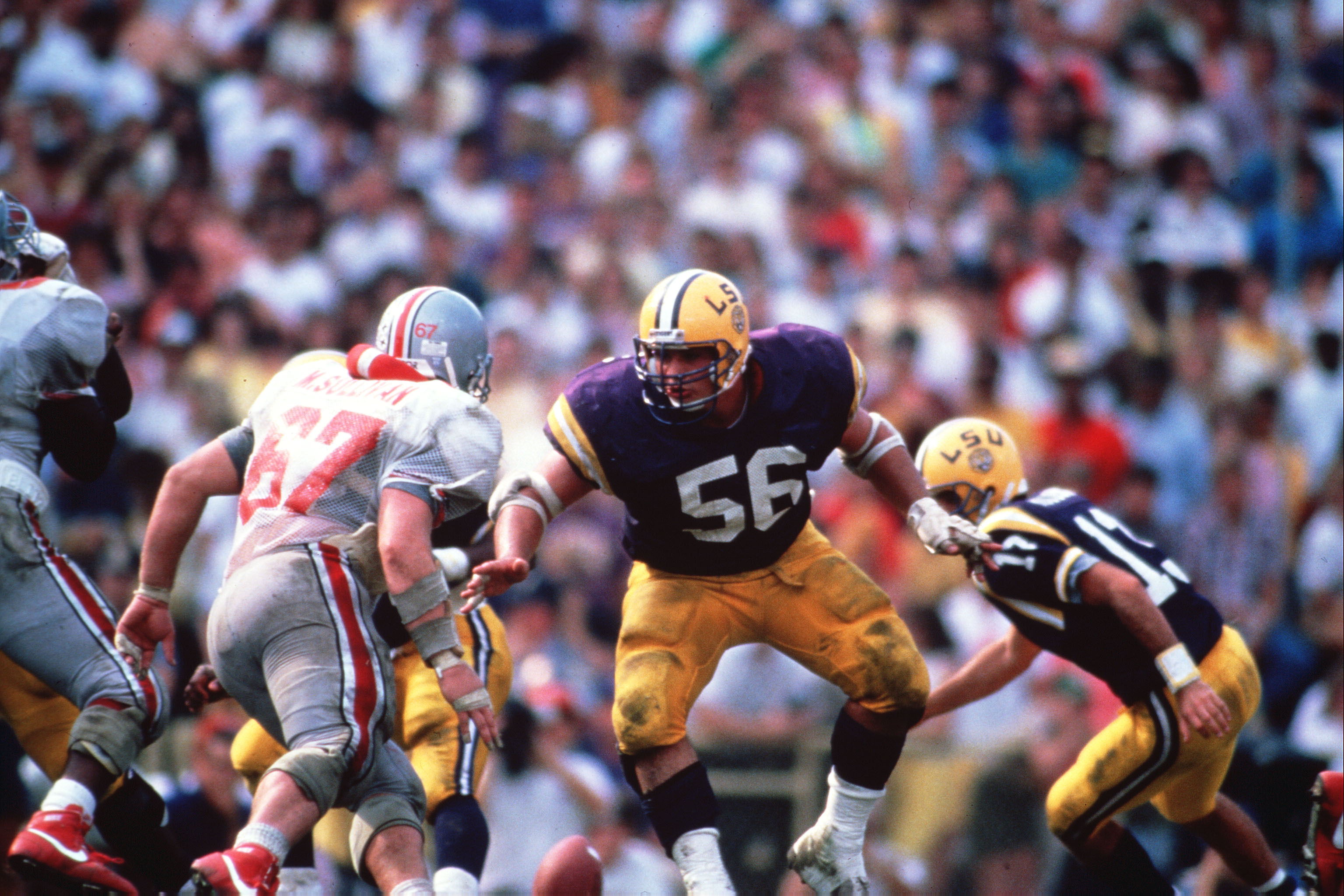 NOVEMBER 14, 1987: Nacho Albergamo #56 center of the Louisiana State University Tigers runs to make the block