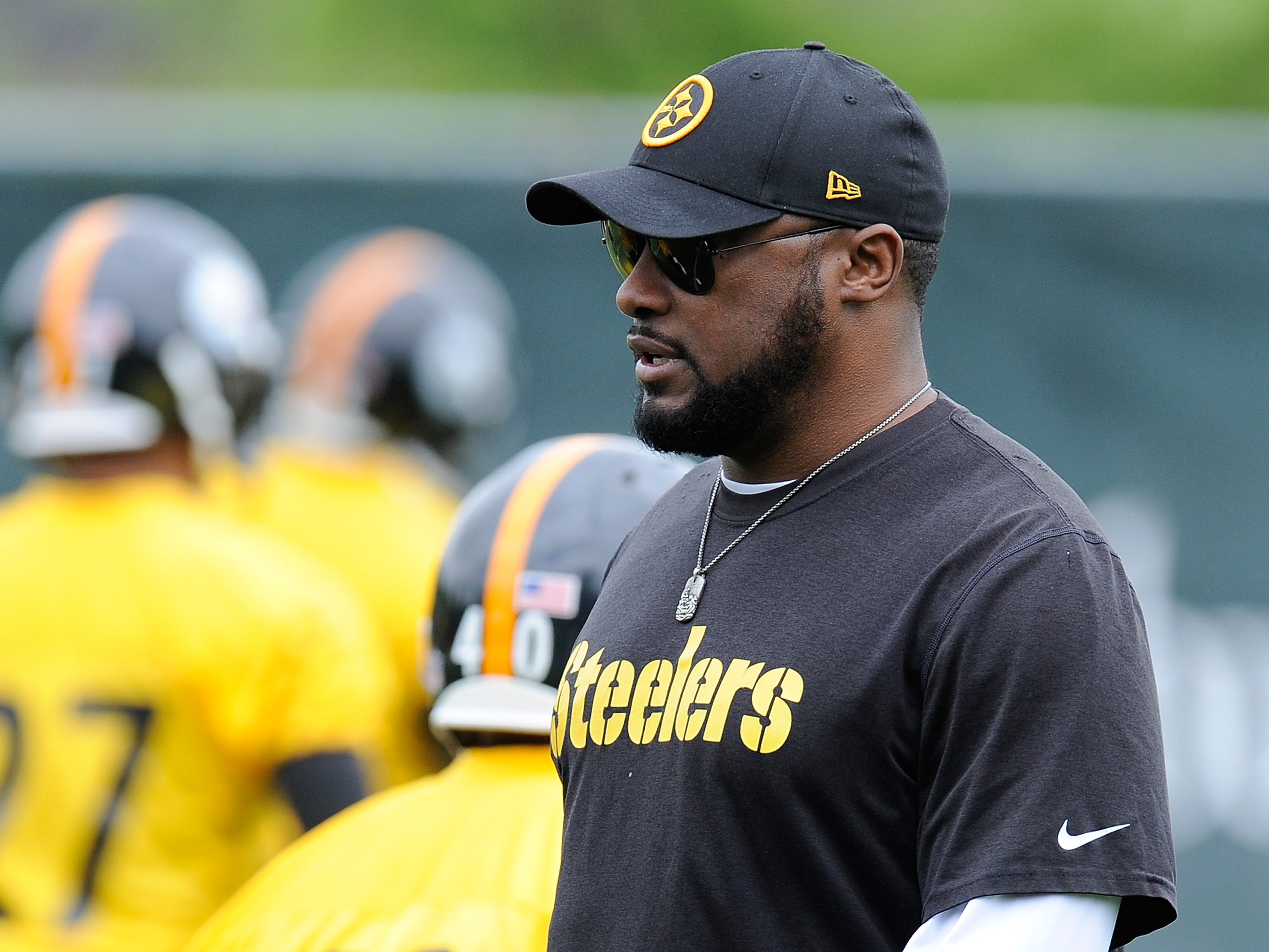 Steelers head coach Mike Tomlin watches over his team at practice from St Vincent College in Latrobe, Pa