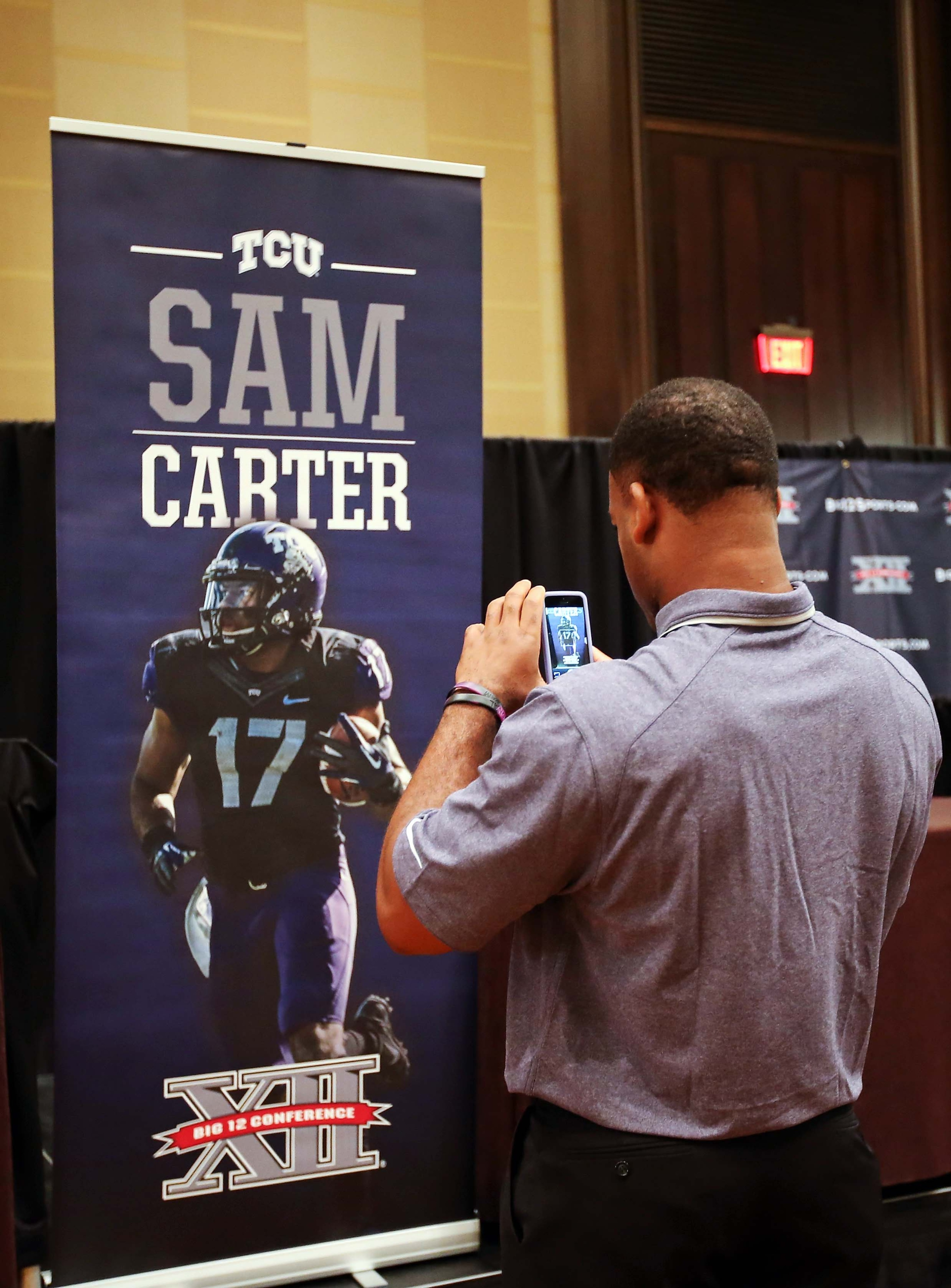 Sam Carter taking a picture of Sam Carter.