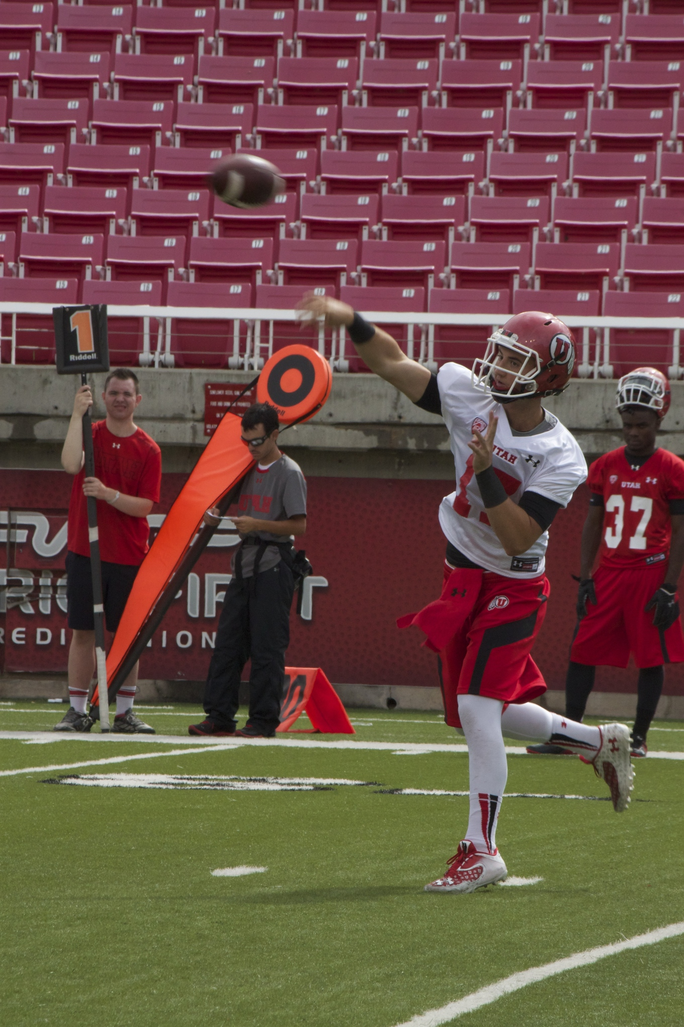 Redshirt freshman Connor Manning steps into a pass at the Utah fall camp this week.